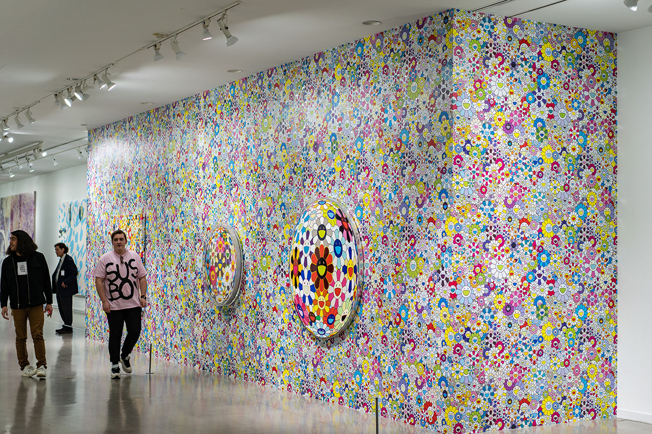 A wall decorated with pieces of Takashi Murakami's signature smiling flowers. One look will instantly brighten your day.