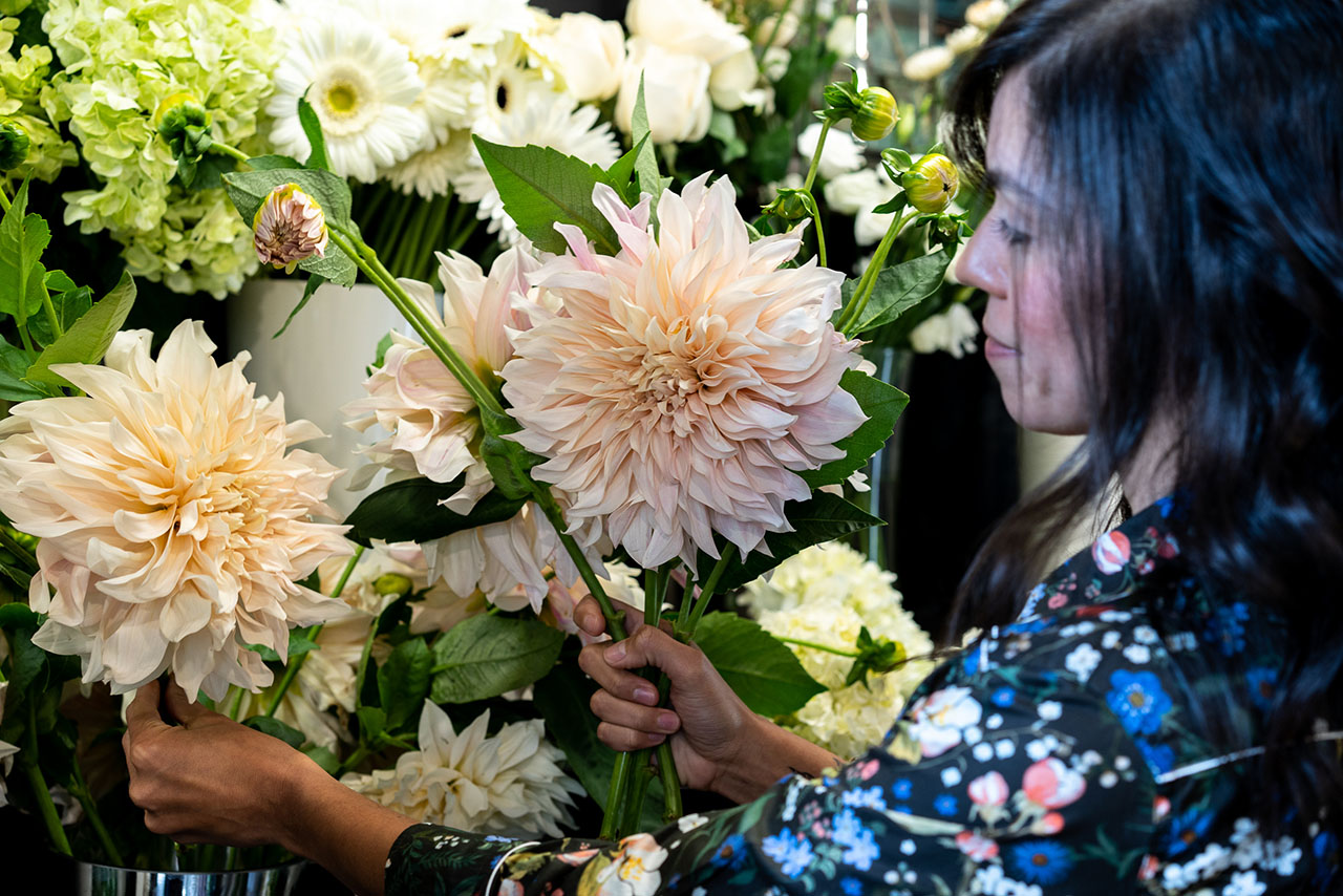 Helen preparing flowers for an arrangement.
