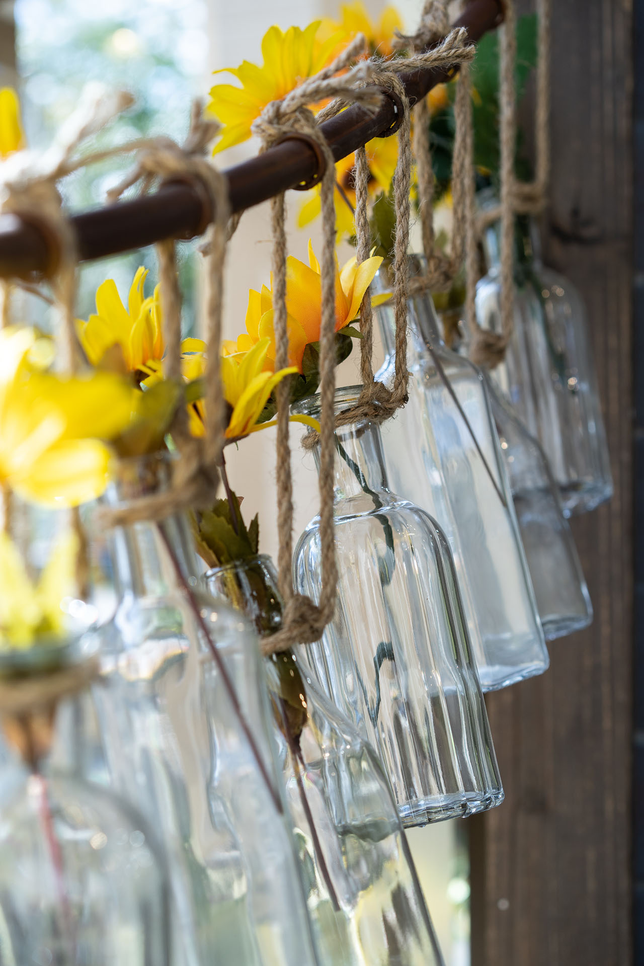Bottle and floral arrangement in the shop window.