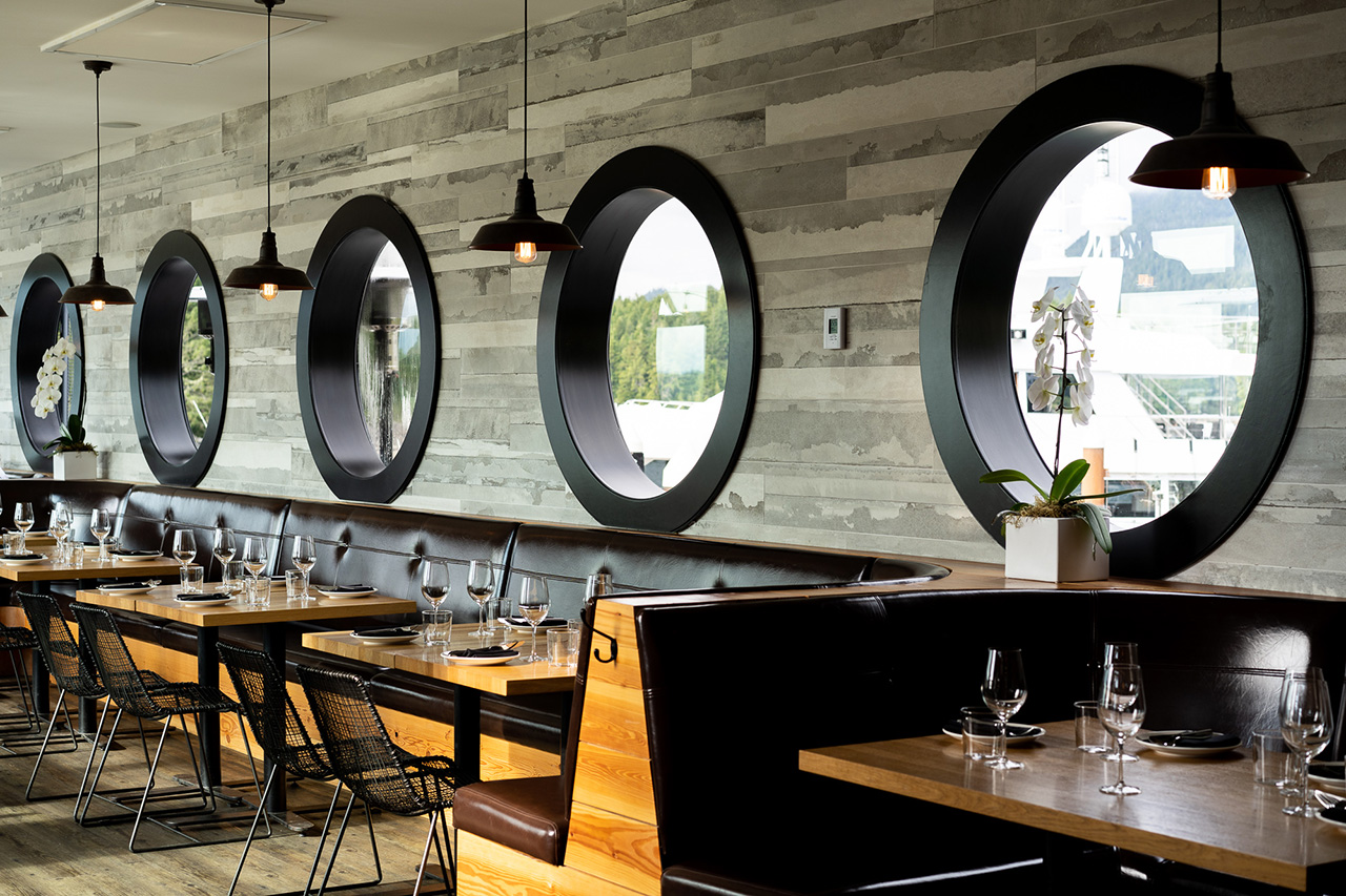Indoor booth seating also gives you views of the water with circular windows.