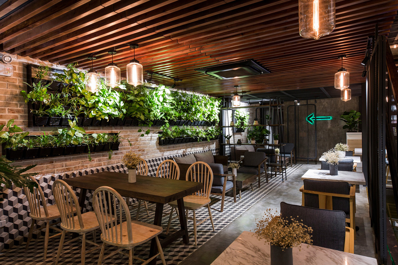 Hanging plants beautify the wall in the ground floor seating area.
