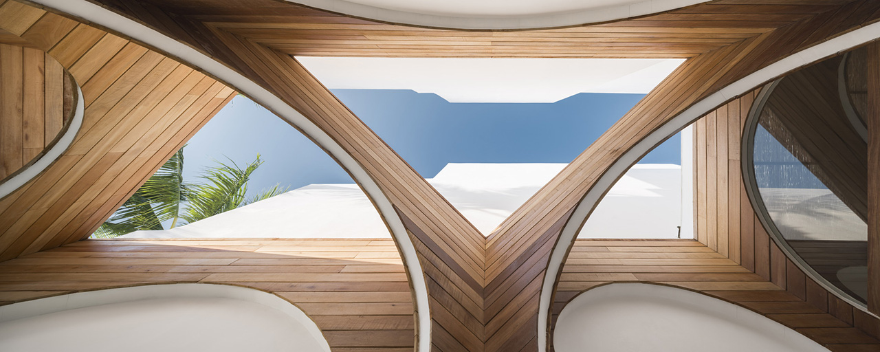 Looking up at the wooden arch design in the resort's public space