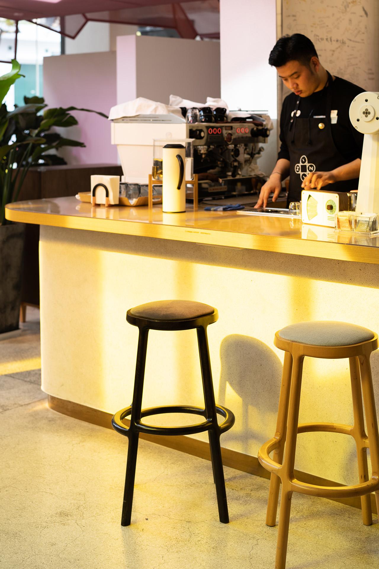 Yellow tinted shadows cast on the café bar counter.