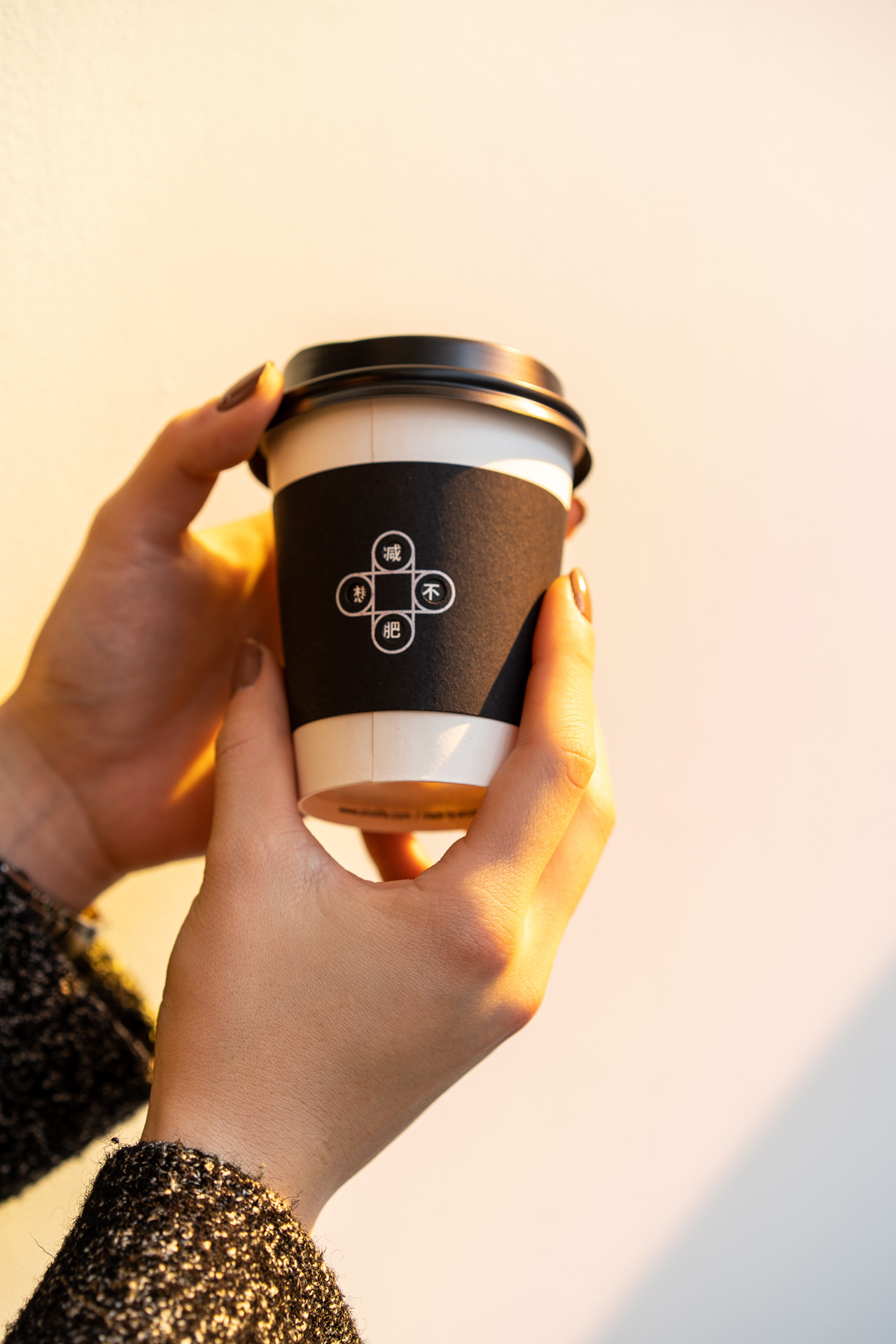 Rotate the cup sleeve to reveal different playful quotes.