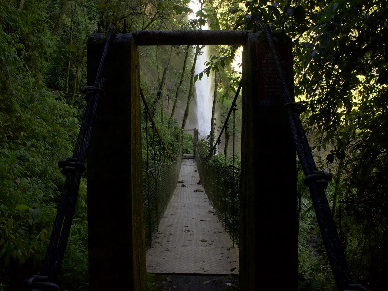 A bridge to enter Machay Waterfall. Baños, Ecuador.