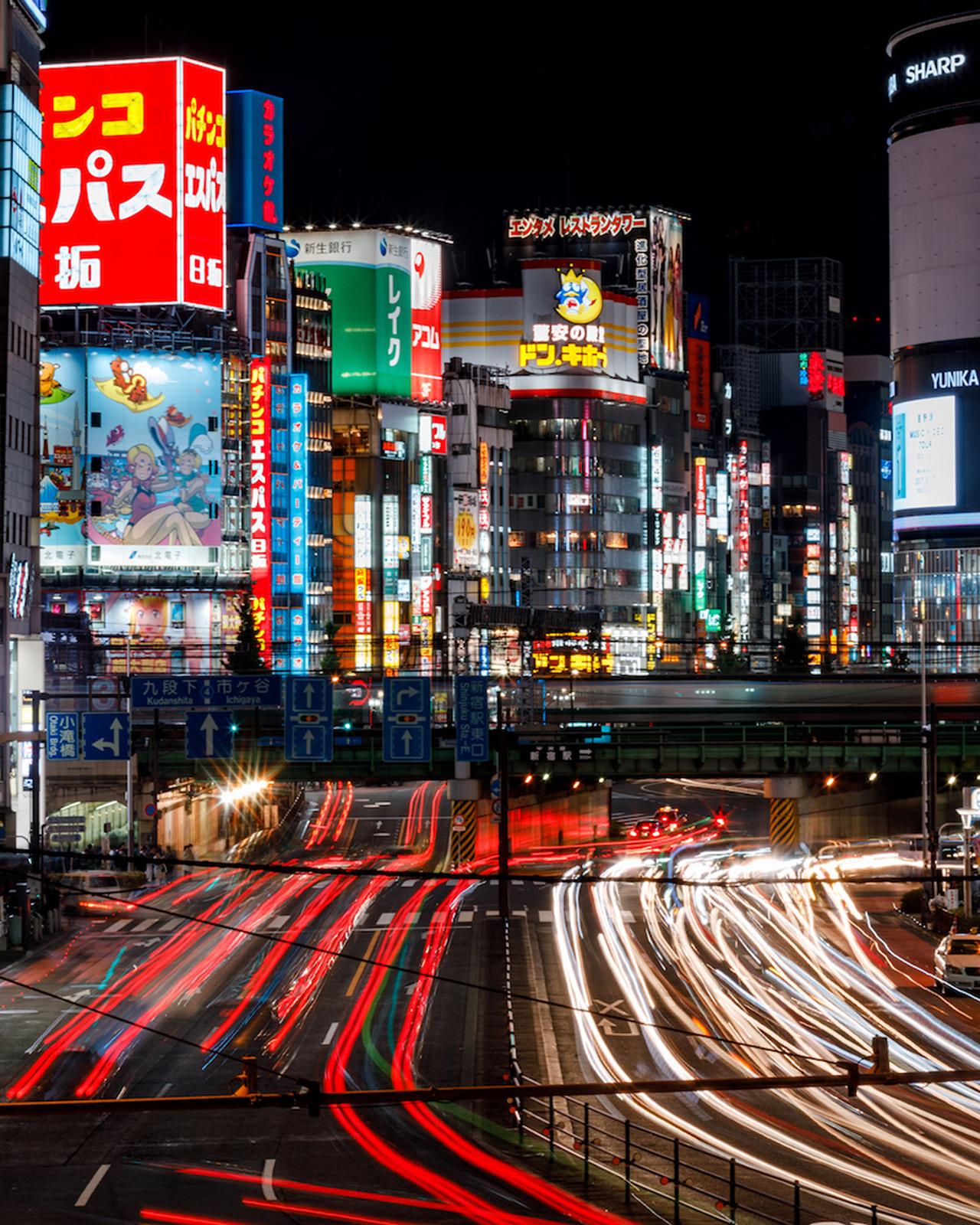 The bustling Shinjuku District at night.