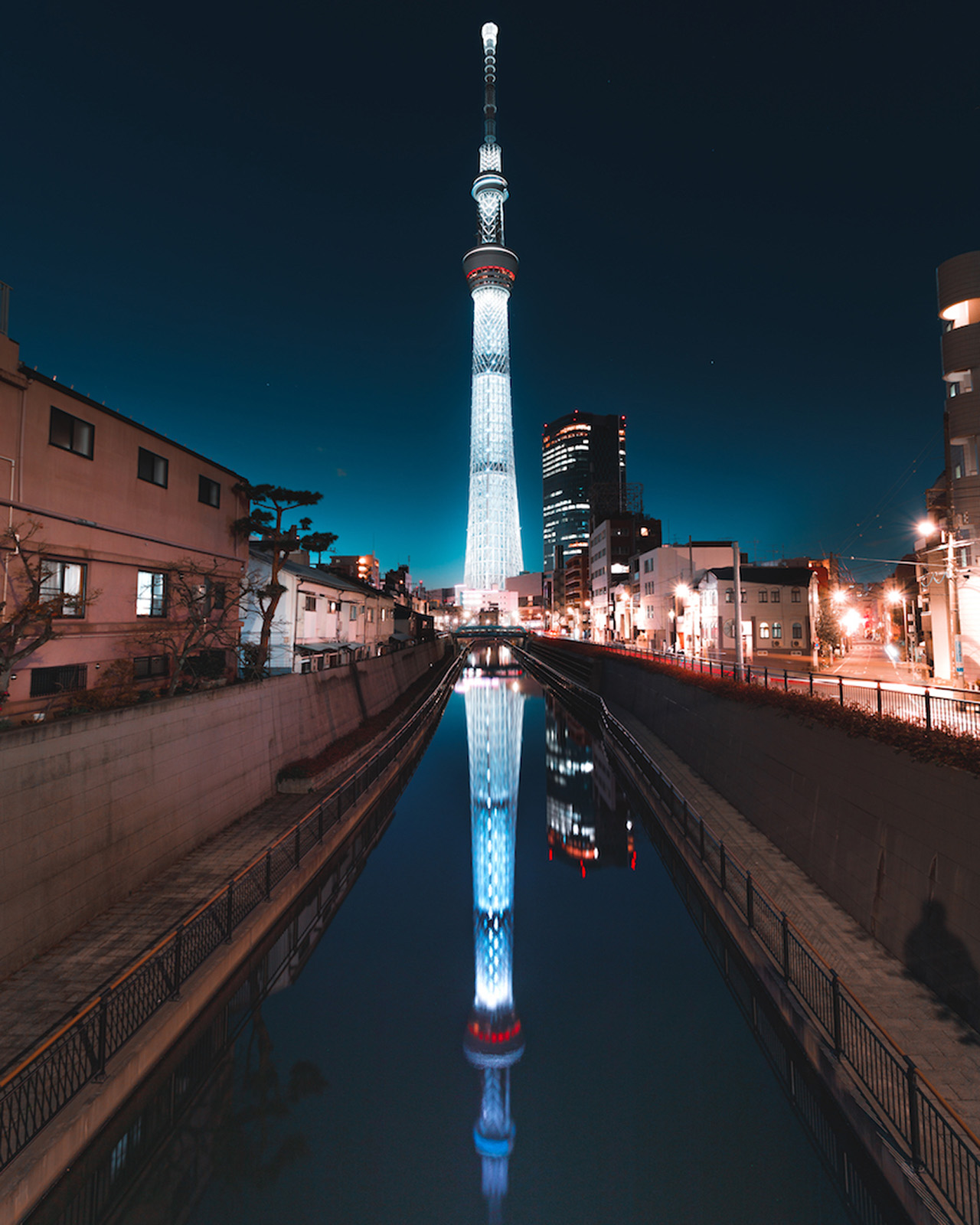 One can escape the sounds of the city in search of a quieter space and sight. The infamous Tokyo Tower as seen from a residential neighbourhood.