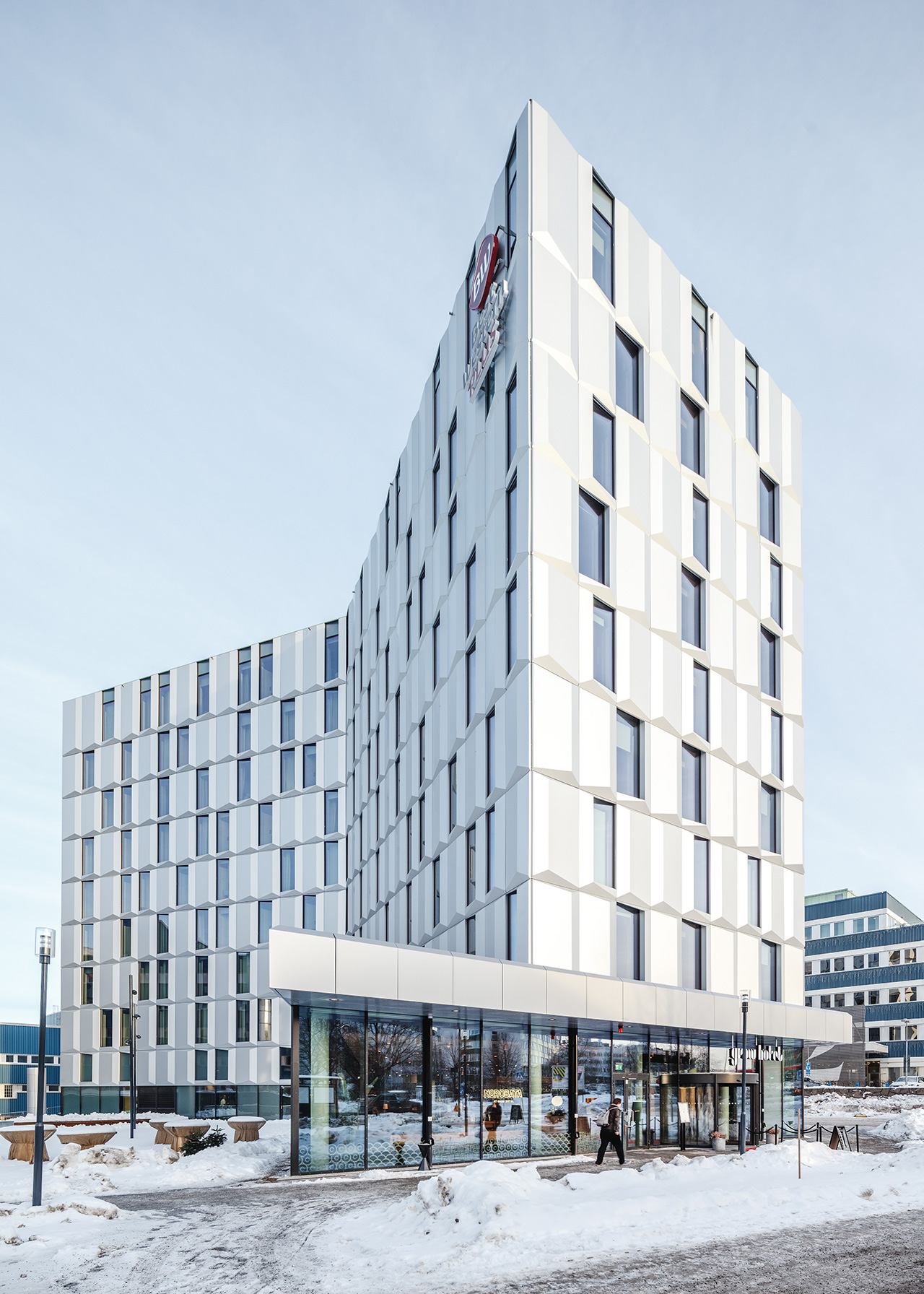 Modular panels transform the building from day to night.