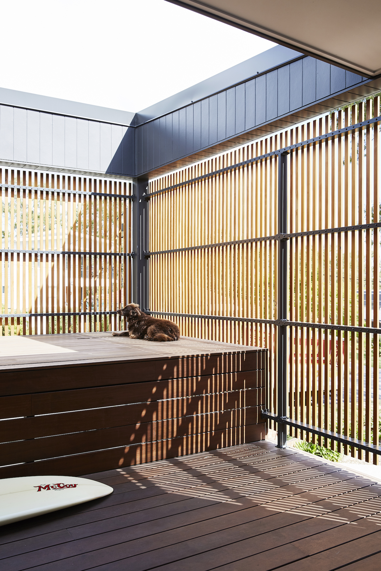 One can relax on the home's outdoor terrace separated by wooden screens for added privacy.