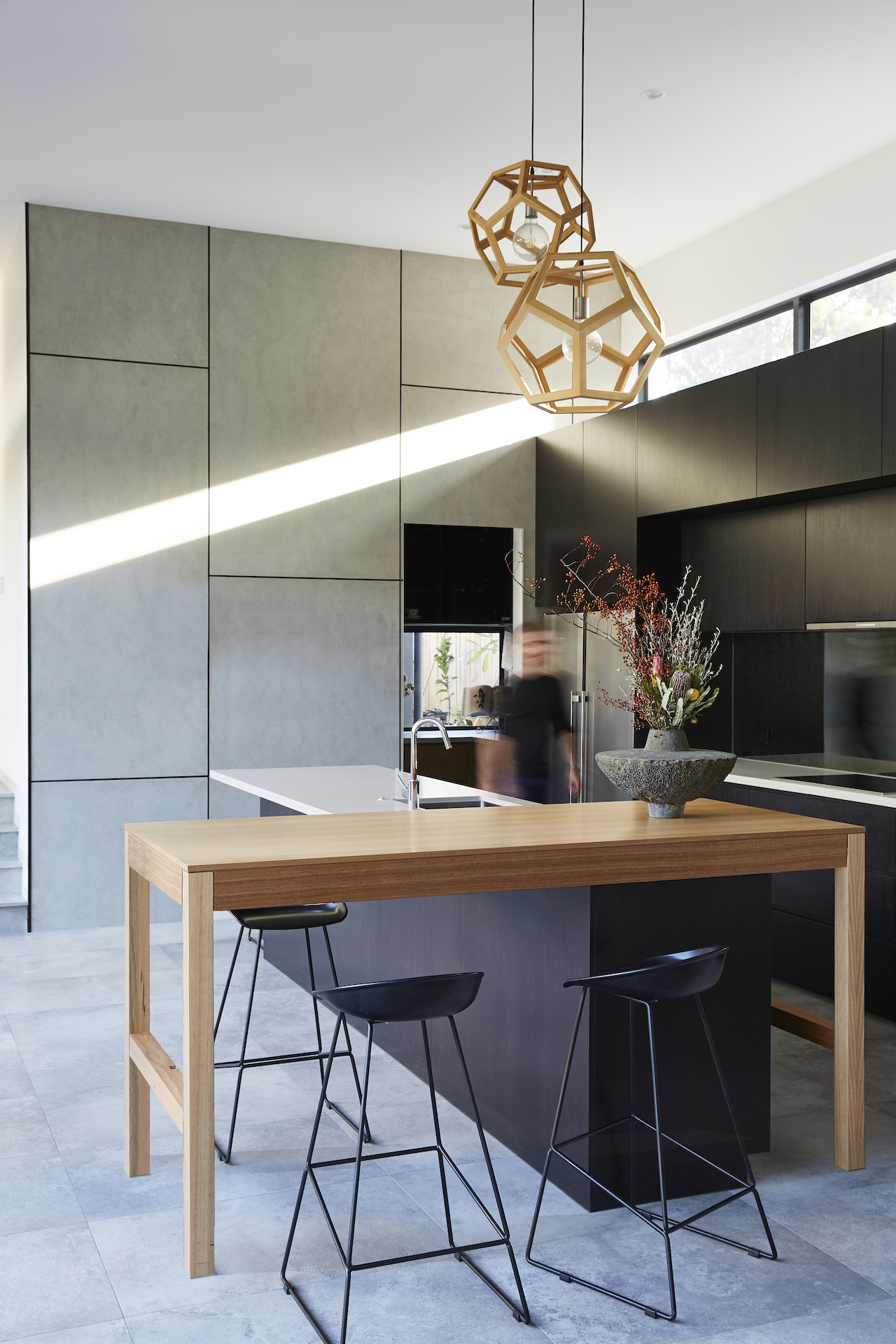 Geometric lines are incorporated throughout the kitchen space.