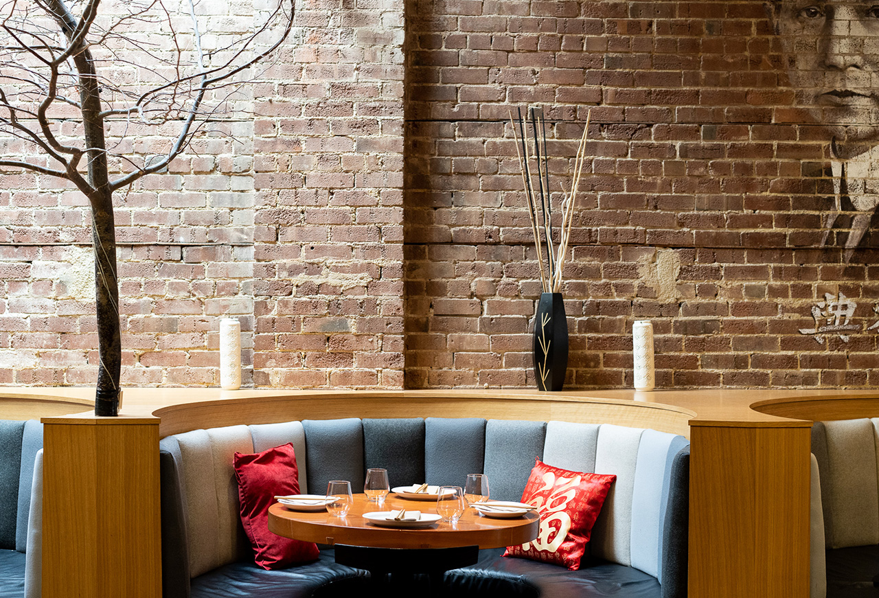 Cozy dining booths accented with red cushions.