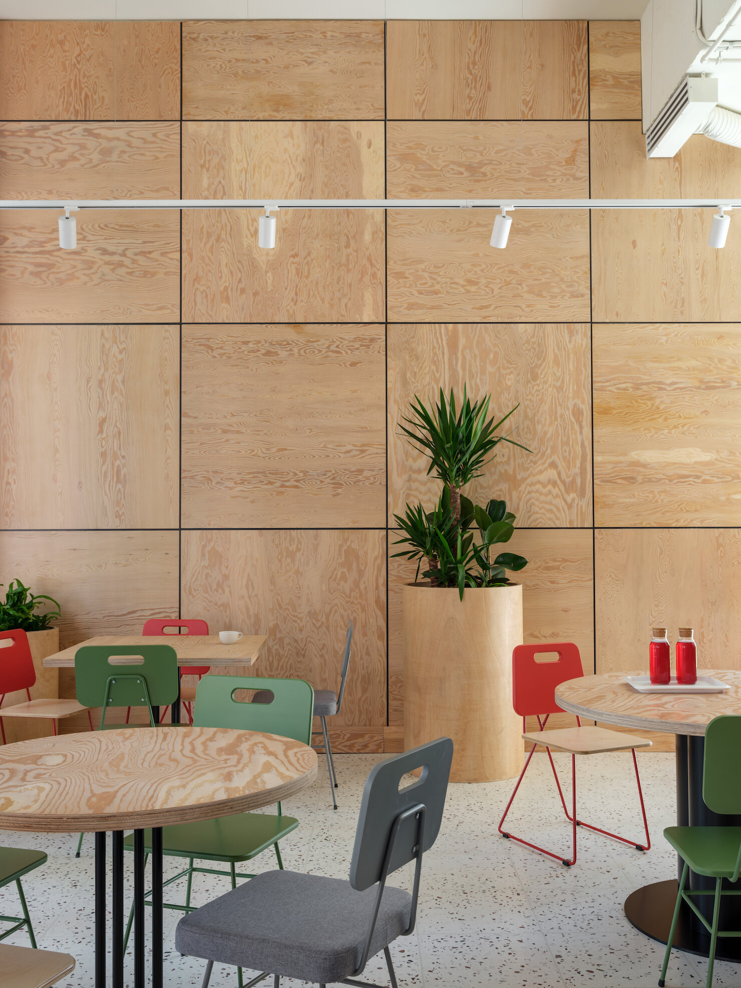 Natural wood grains on the wall panel adds texture and complexity to the large walls.