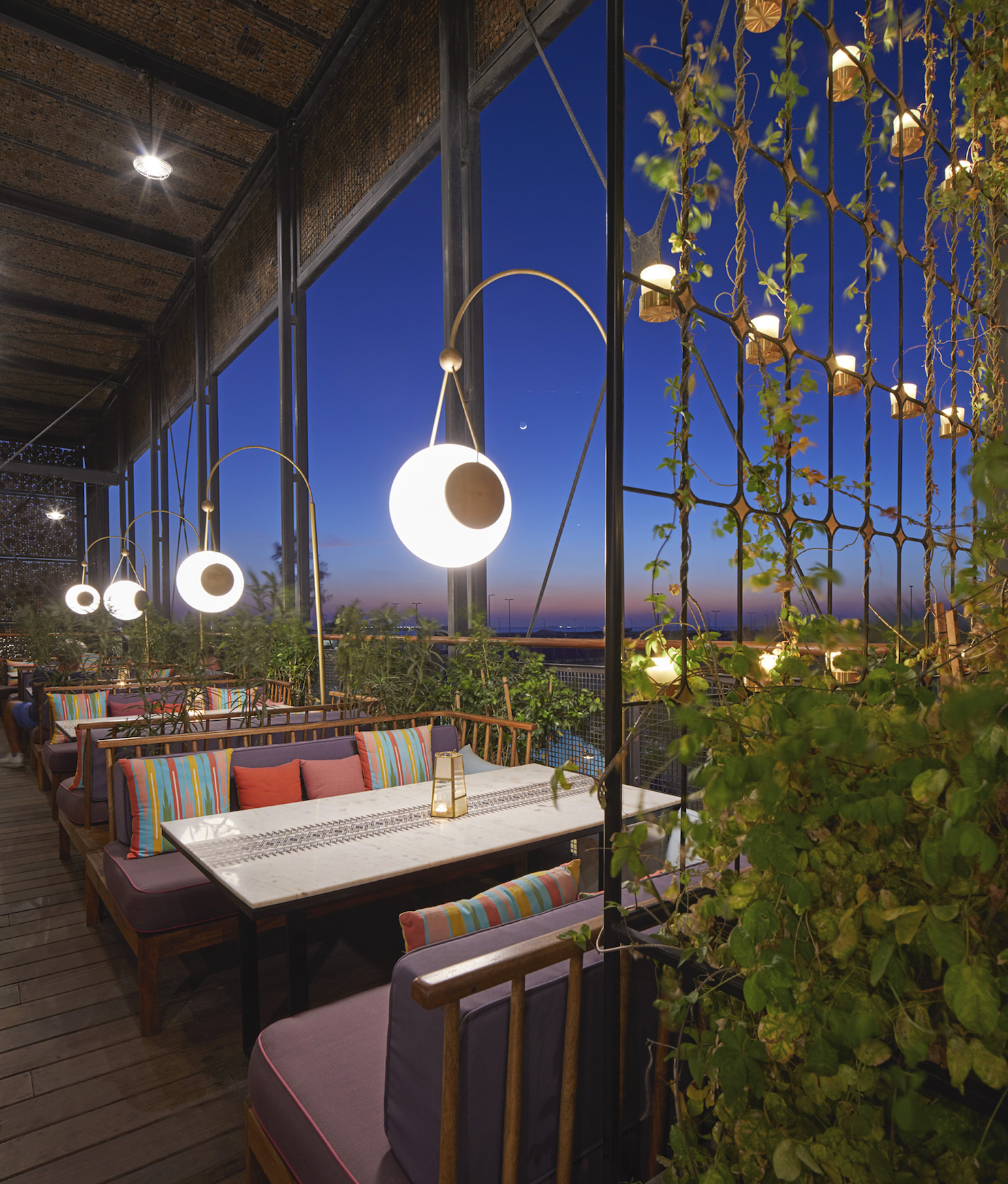 The restaurant terrace with a view of the sunset.