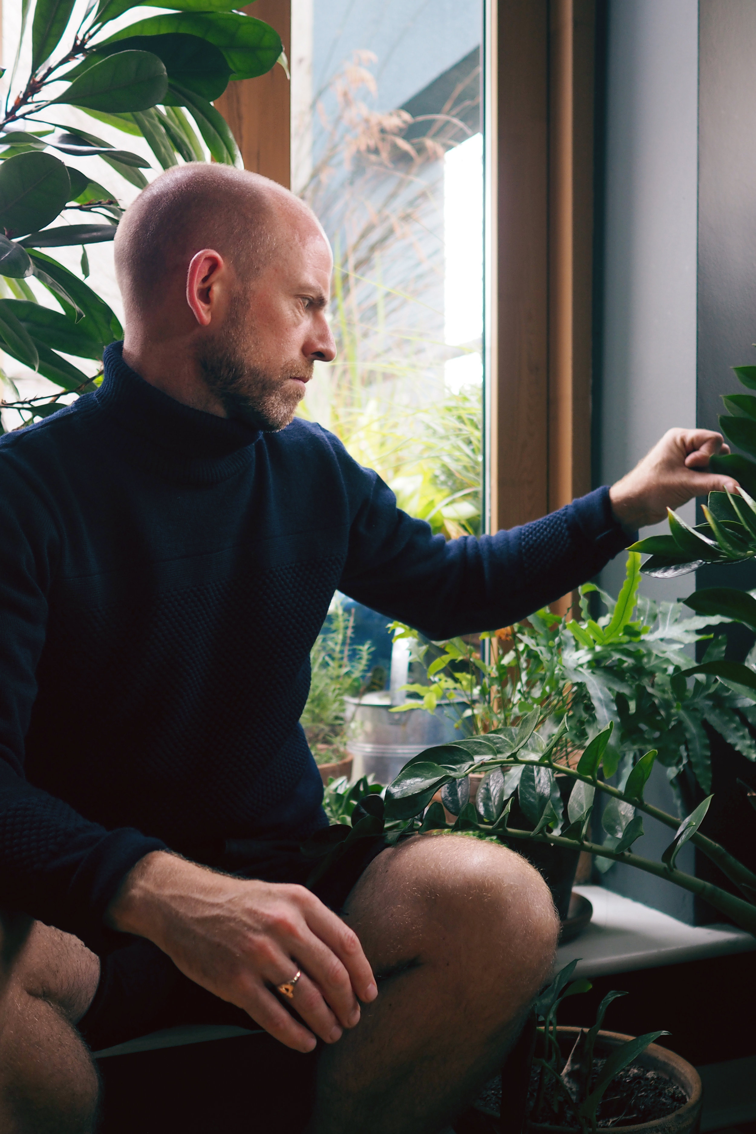 Next, the wool roll neck is by Danish label   Norse Projects  . The denim shorts and Claddagh ring are Mark's own.