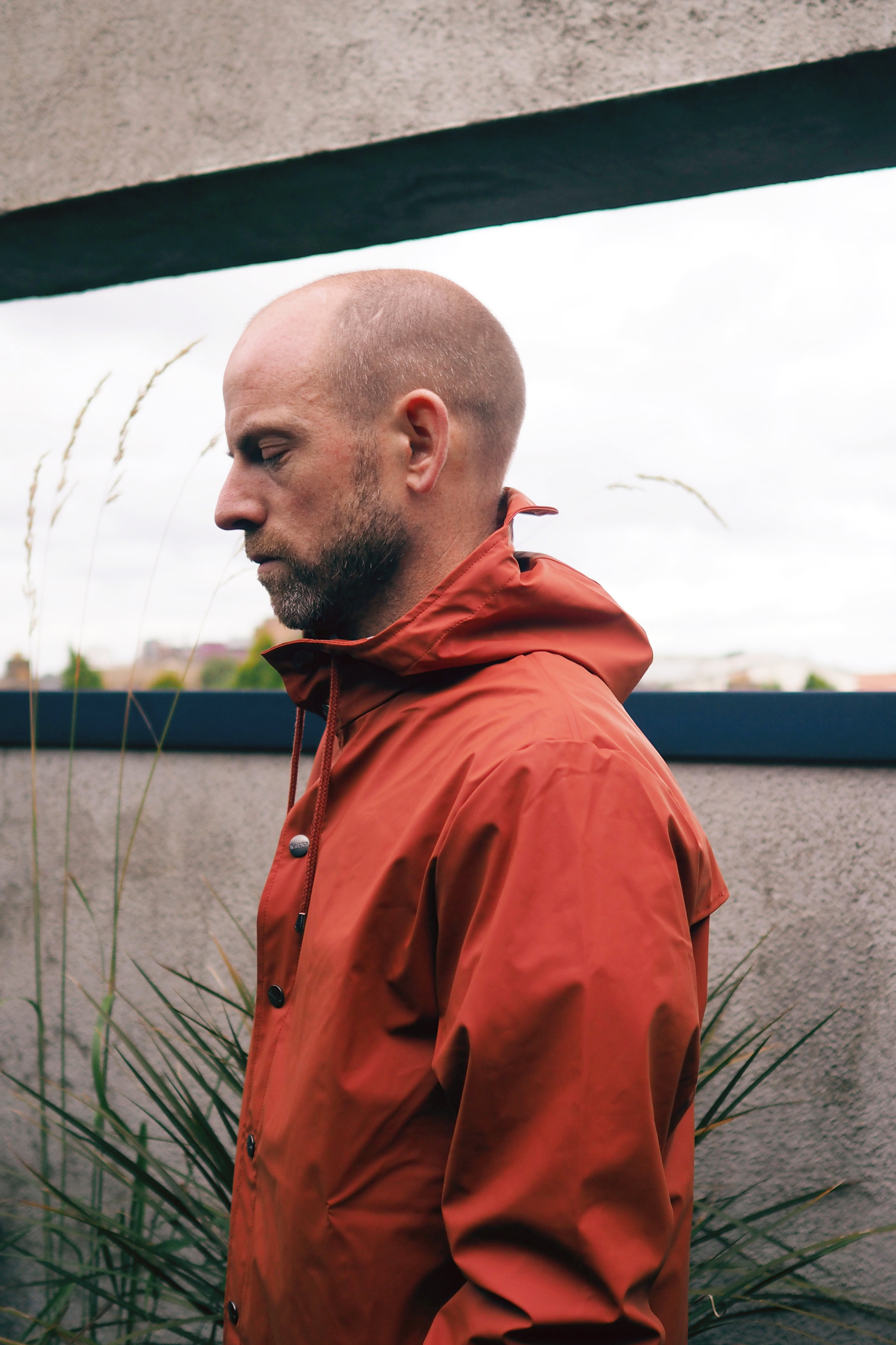 Finally, Mark remains protected from the elements in a very autumnally coloured anorak from Danish brand  Rains .