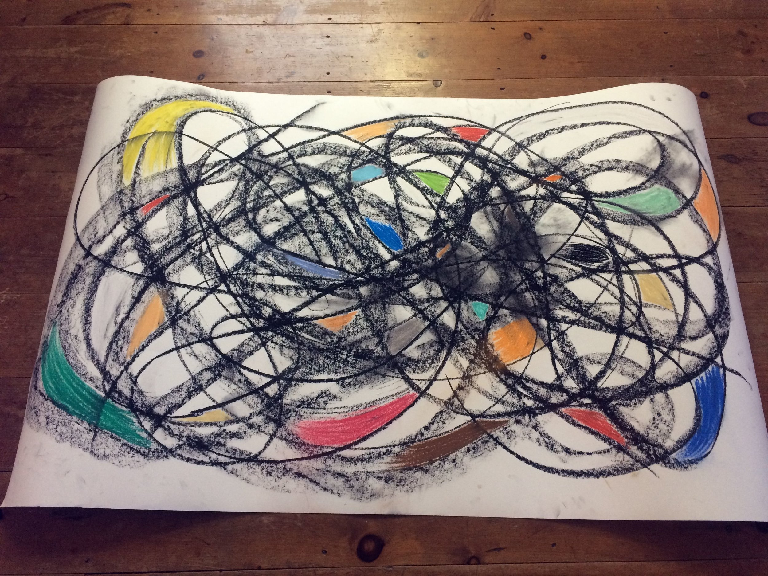 """E MERGE Interdisciplinary Collaborative Residency 2019.  E MERGE Presents...   """"Everything is MOVEMENT for me. I tune in to where energy wanna travel and what it wants to say""""   Charcoal chunk and soft pastel, 36"""" x 60"""" (92 cm x 152 cm) on 140lb Bee Watercolor paper.  Produced by Cory Neale & Earthdance."""