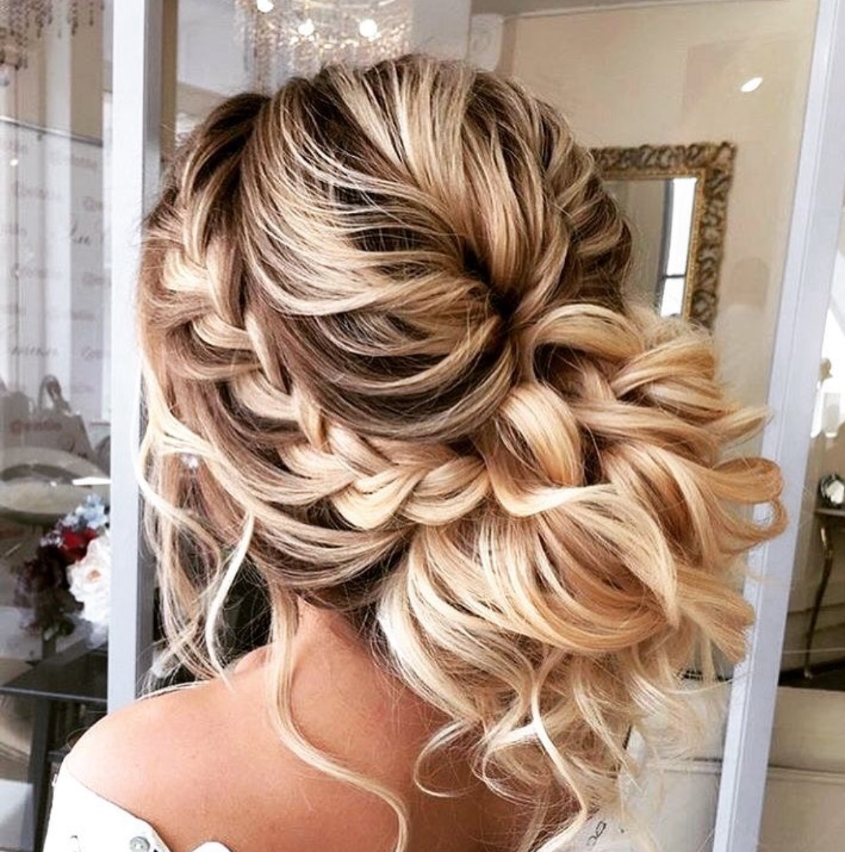 A side braid with this beautiful mess of curls from  @chilhambridal
