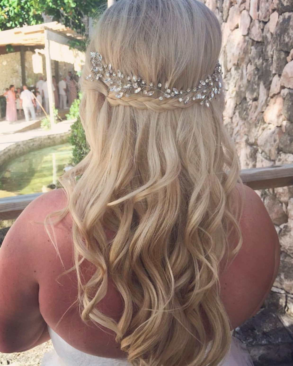 A simple braid and long curls plus this great jeweled hairpiece from @ annauet_inyourwedding