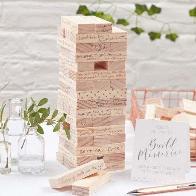 For the game-loving couple, instead of a guest book, have your guests write notes on Jenga pieces. It's a momento you'll cherish and actually be able to put to use every time you have game night post-wedding!😍 • • • • • • • • • • 📸: @weddingideas • • #weddingalchemist #weddingalchemisttips #thingscoachessay #coachinglife #coachingtip #coachingtips #weddingtips #weddingtip #womeninbusiness #womenentrepreneurship #iloveyou #bride #groom #weddings #wedding #springwedding #springtime #spring #mayflowers #weddingseason #aprilwedding #jenga #games #weddingplans #weddingplanning #weddingideas #coupleswhogame #guestbook #regram #repost