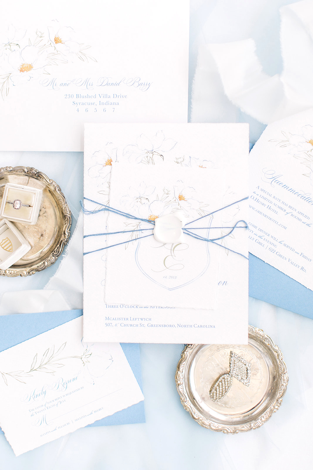 Blank seal with blue cord wrapped invitation. Fine Art, Ethereal wedding staitonery with a fresh twist.  Bolder color and some modern florals bring fresh life to your wedding stationery.  Blushed Design: Wedding Invitations and FIne ARt Portraits