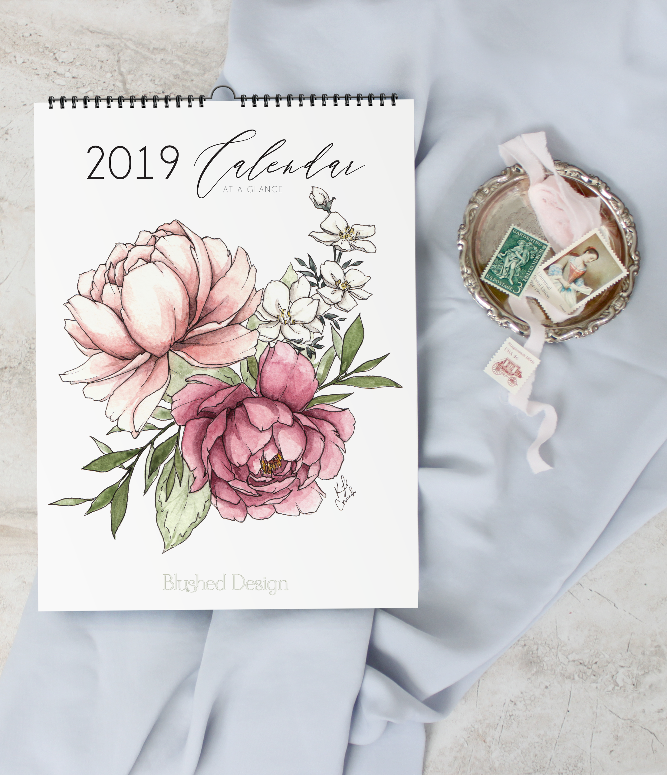 2019 wall calendar design featuring 12 watercolor botanicals. #watercolorflowers #watercolortutorial #botanicalcalendar www.BlushedDesign.com