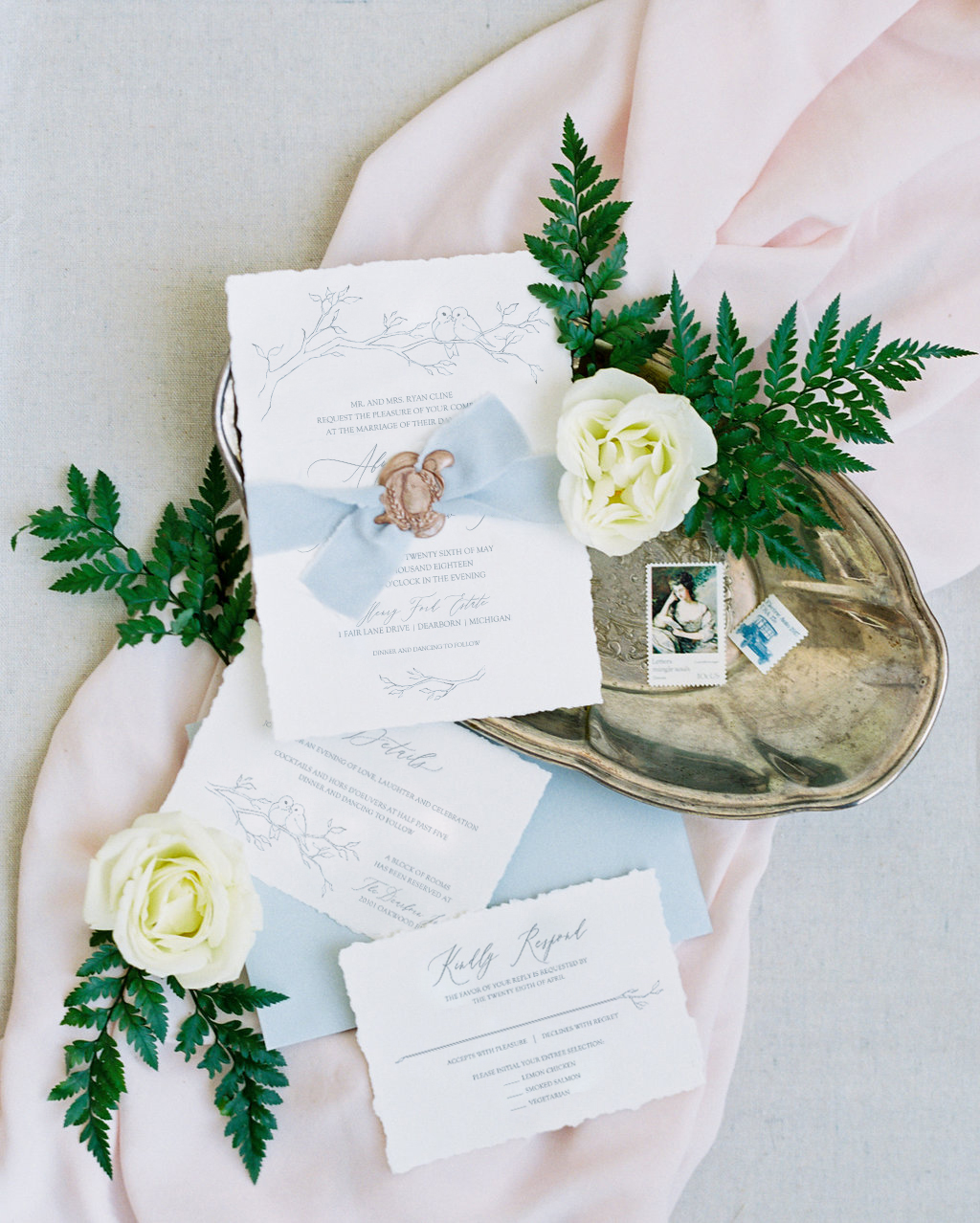 Fine art blue wedding invitations featuring handmadepaper and a delicate illustration with a pair of darling little birds!  These wedding invitations are perfect for a garden or outdoor wedding. #midwestwedding #weddinginspiration #fineartwedding