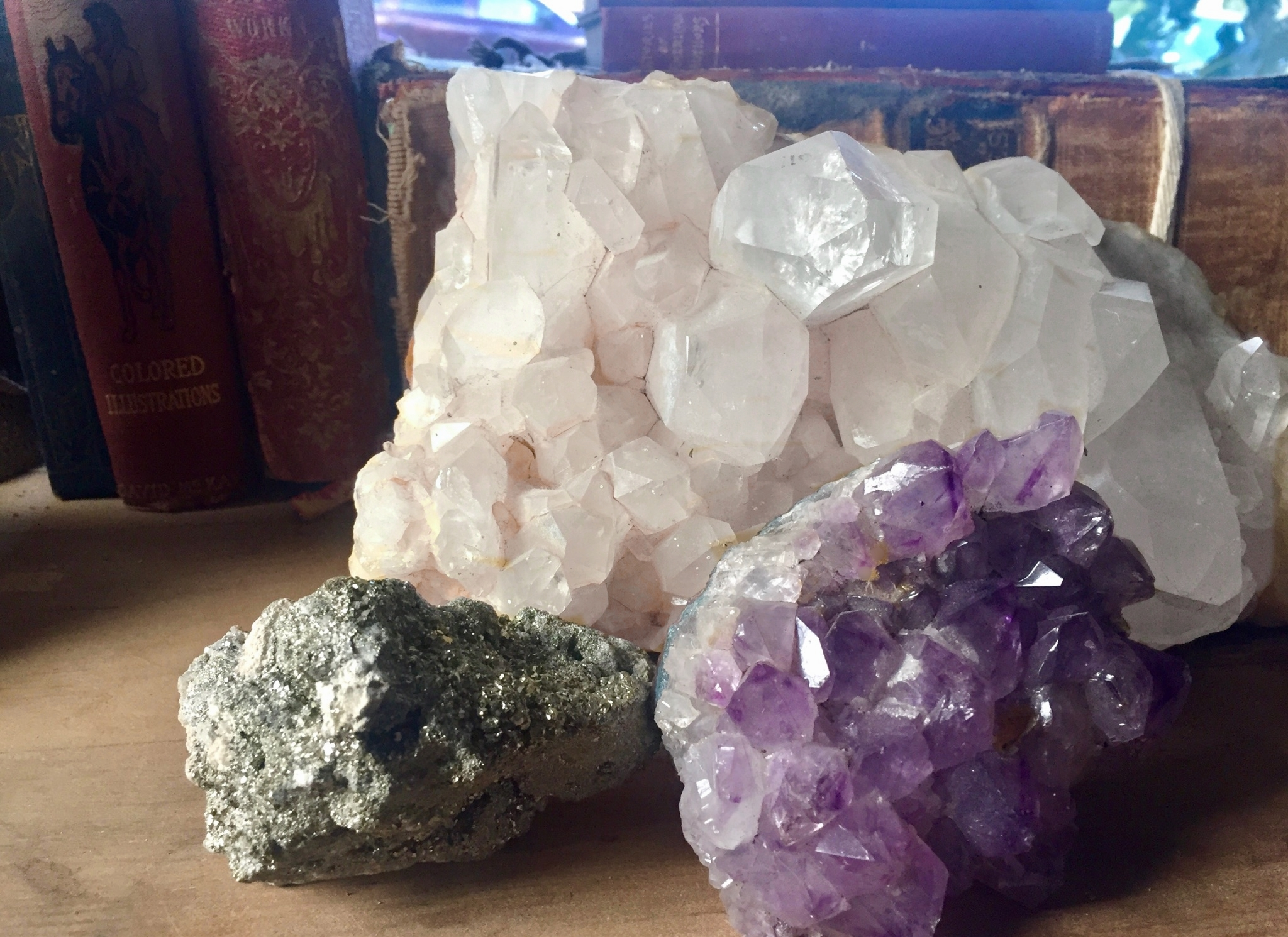 There's strength in numbers when grouping gemstones. Shown counter clockwise is pyrite, amethyst and angel quartz. Come grab your grouping at Filthy Gorgeous.