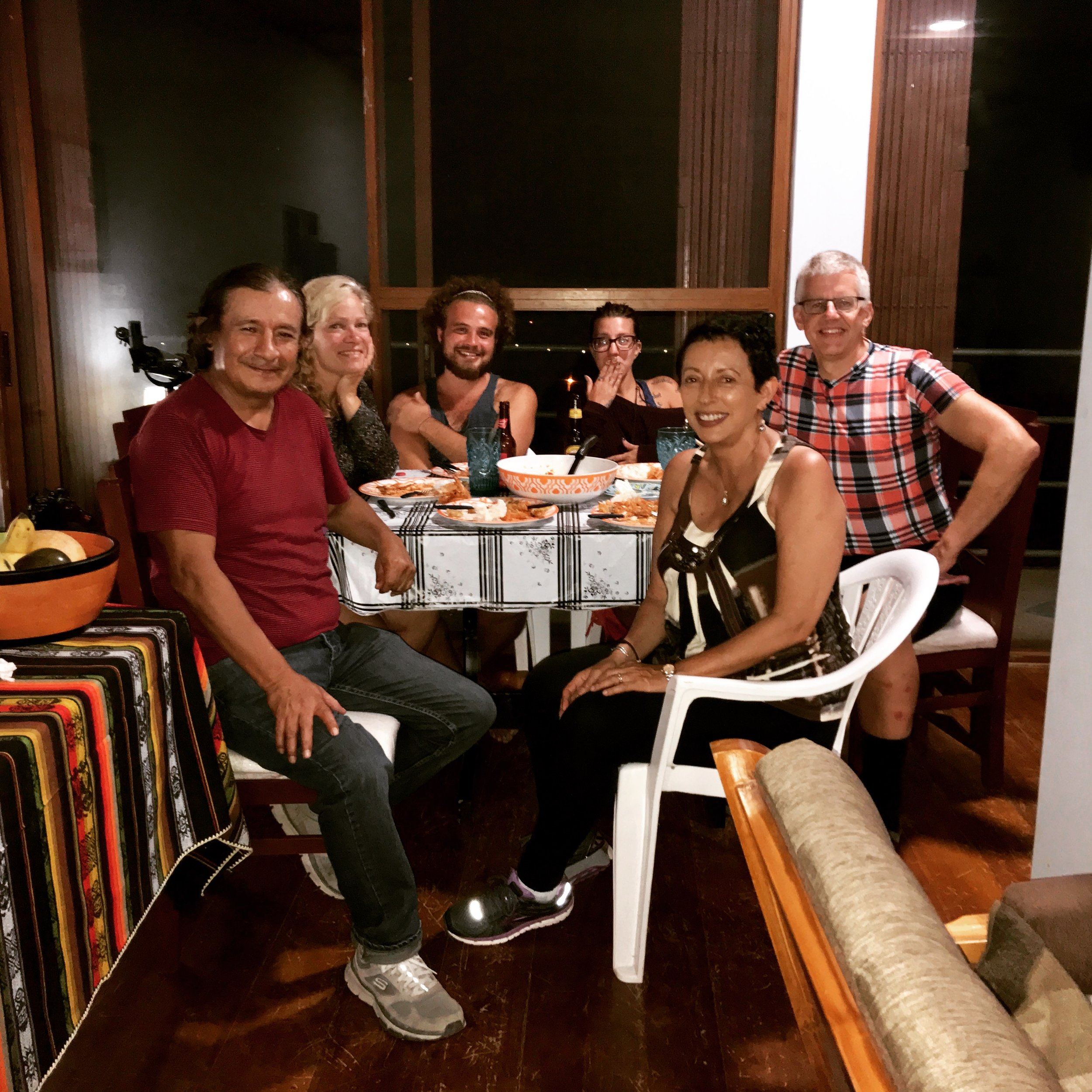 Our workaway volunteers trying out an Ecuadorian meal with us.