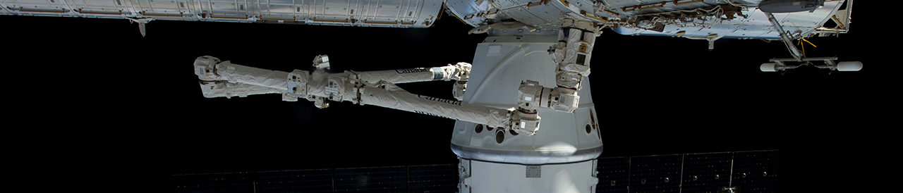 A file photo of a previous Dragon berthed with the International Space Station. Photo Credit: NASA