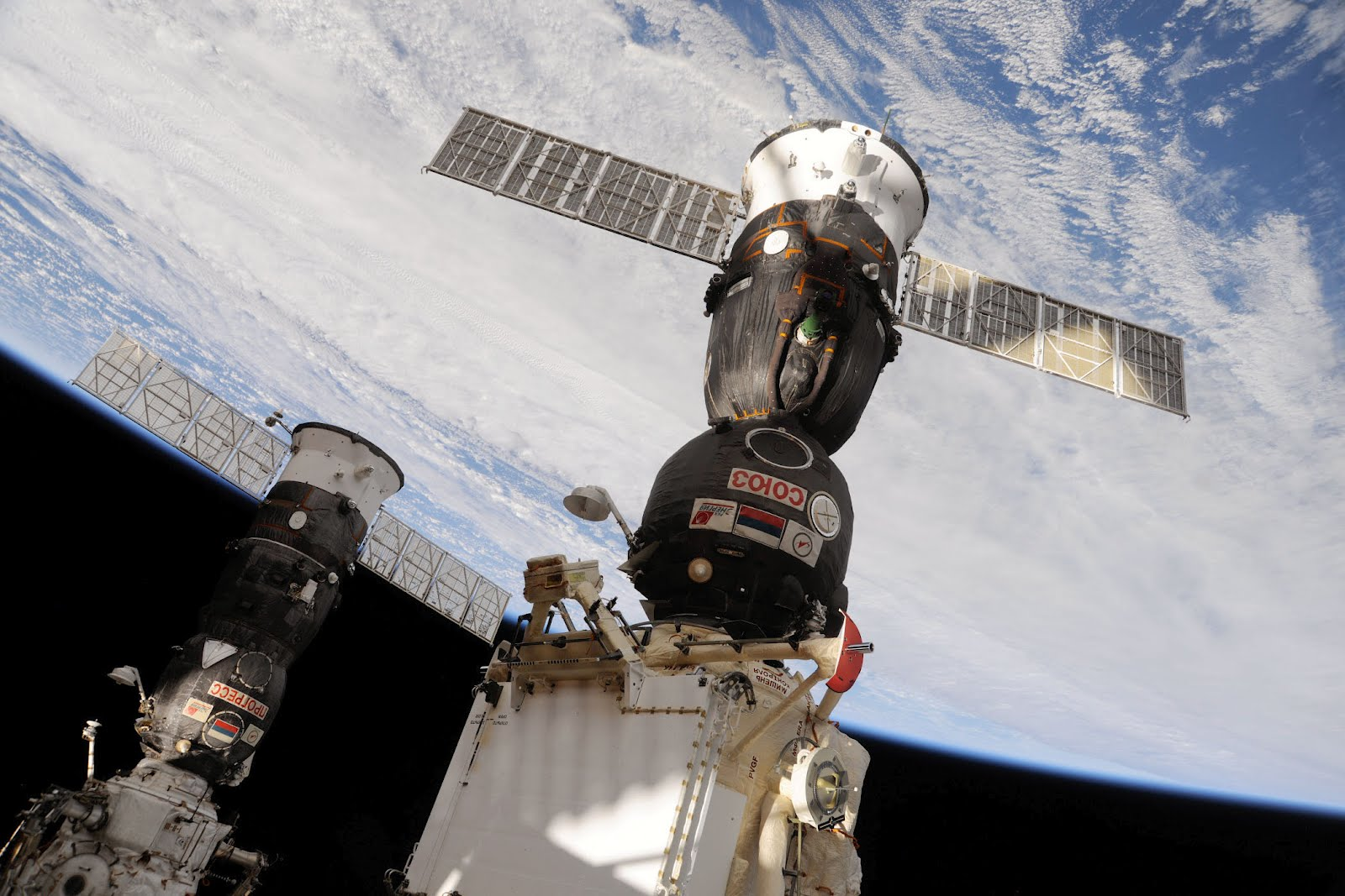 Earth rotates beneath a Soyuz docked to the  Rassvet  module of the International Space Station. Photo Credit: NASA