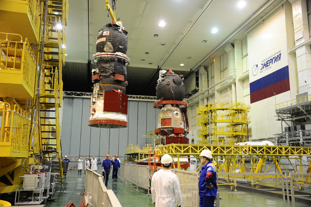 Technicians at Baikonur Cosmodrome in Kazakhstan ready a Progress for flight. Photo Credit: RKK Energia