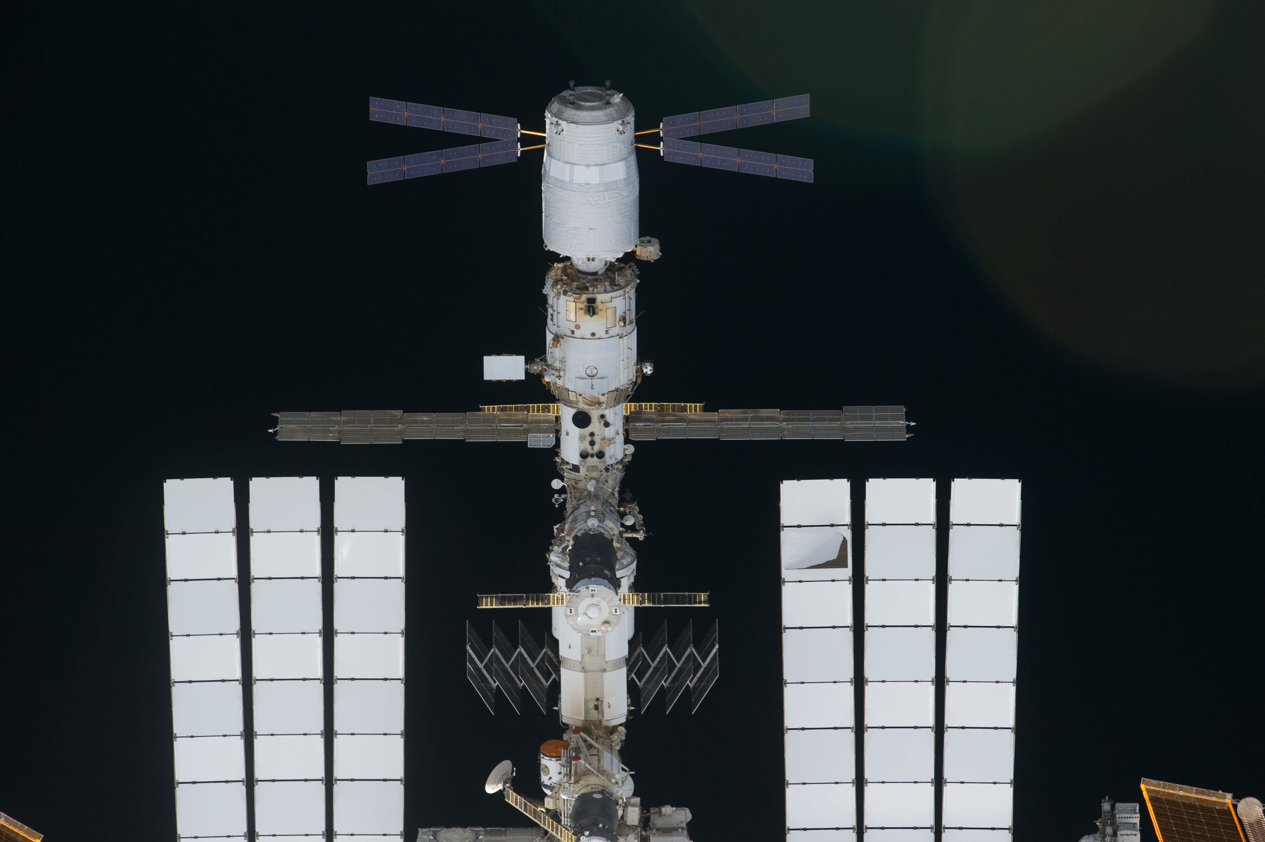 A view of the Russian Orbital Segment outpost with ATV docked. Photo Credit: NASA