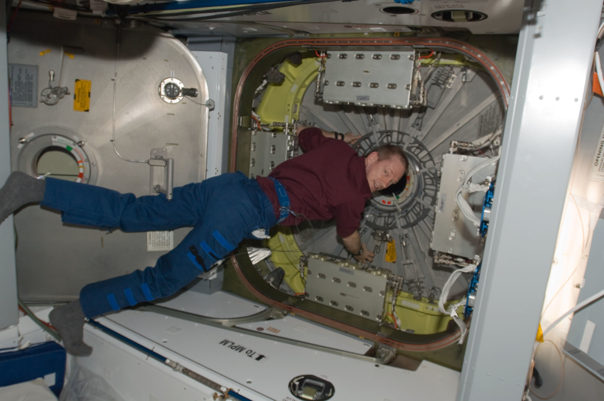 Belgium astronaut Frank De Winne prepares to open the Kounotori's hatch. Photo Credit: NASA