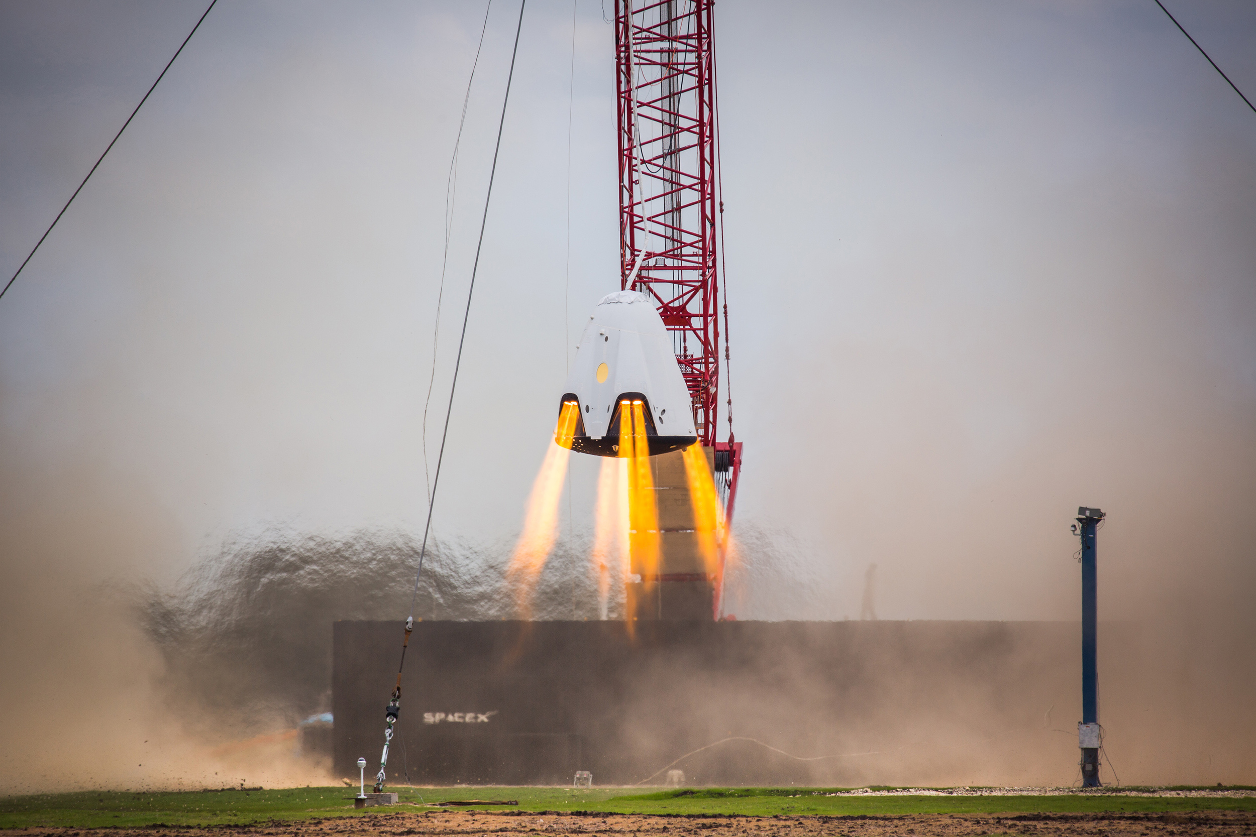 SpaceX tests the Crew Dragon's hover capability in Texas in their efforts to propulsively land the craft in the future. Photo Credit: SpaceX