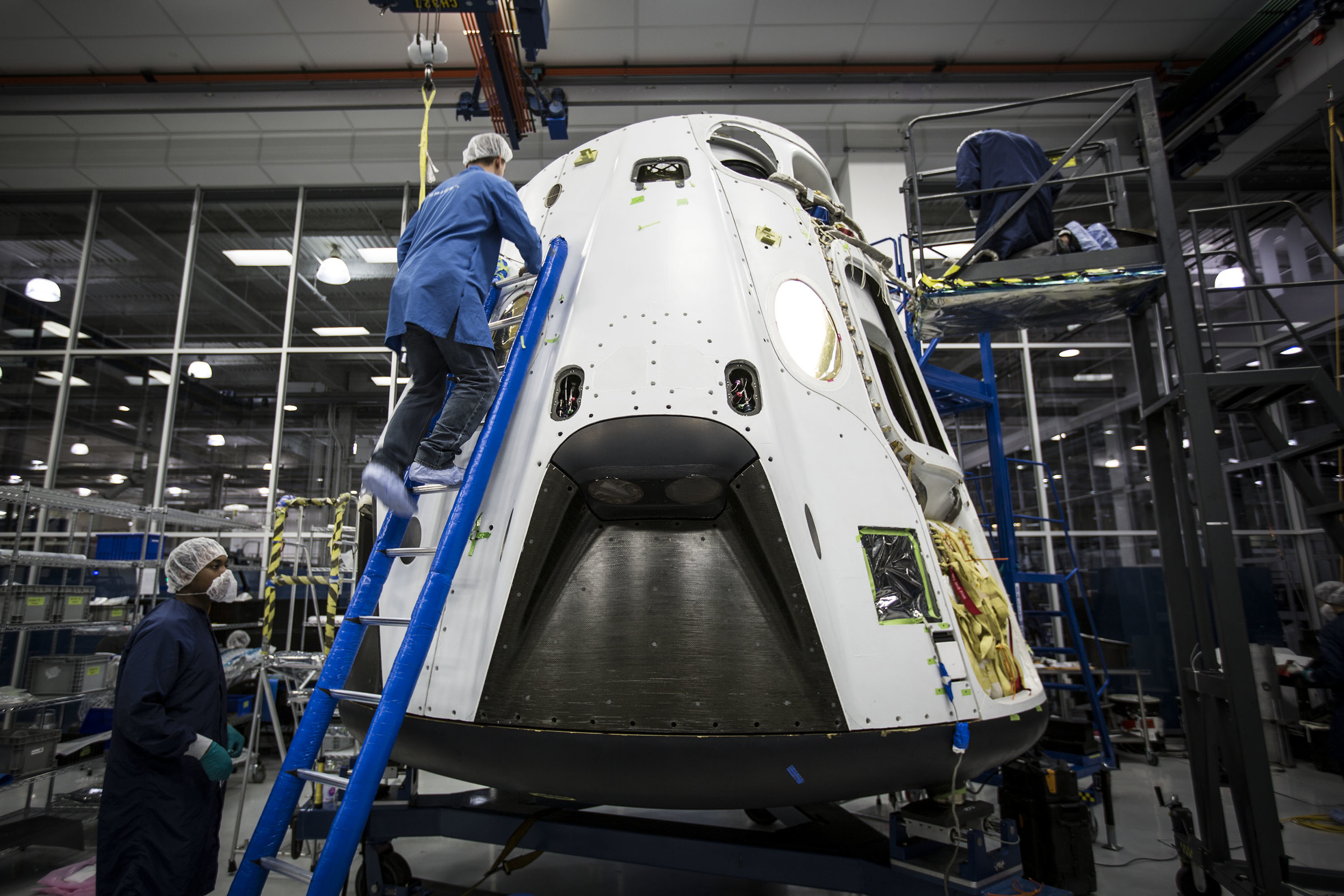 Engineers prepare a Crew Dragon for the Pad Abort test in 2015. Photo Credit: SpaceX