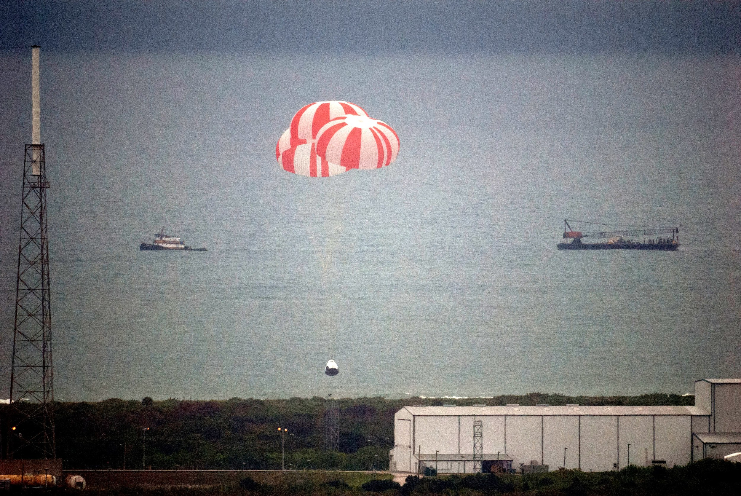 The Crew Dragon capsule parachutes into the ocean after the Pad Abort test. Photo Credit: SpaceX