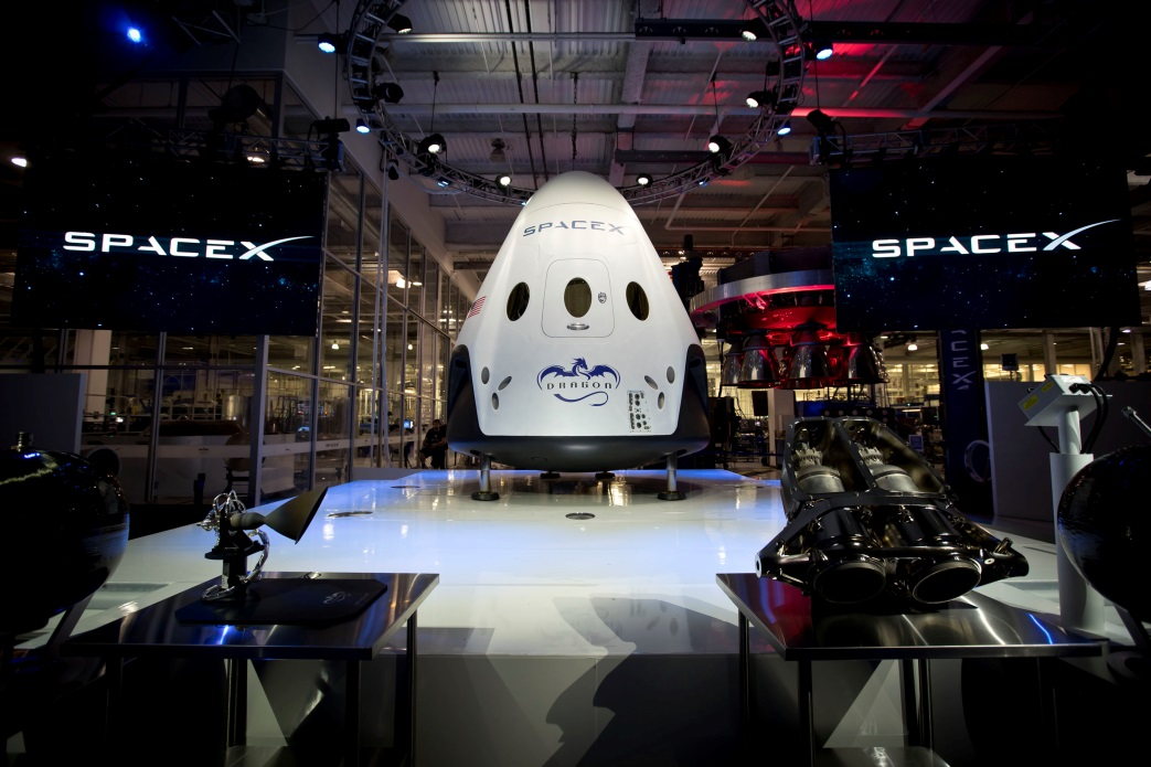 The Crew Dragon is unveiled at SpaceX headquarters in May 2014. Photo Credit: SpaceX