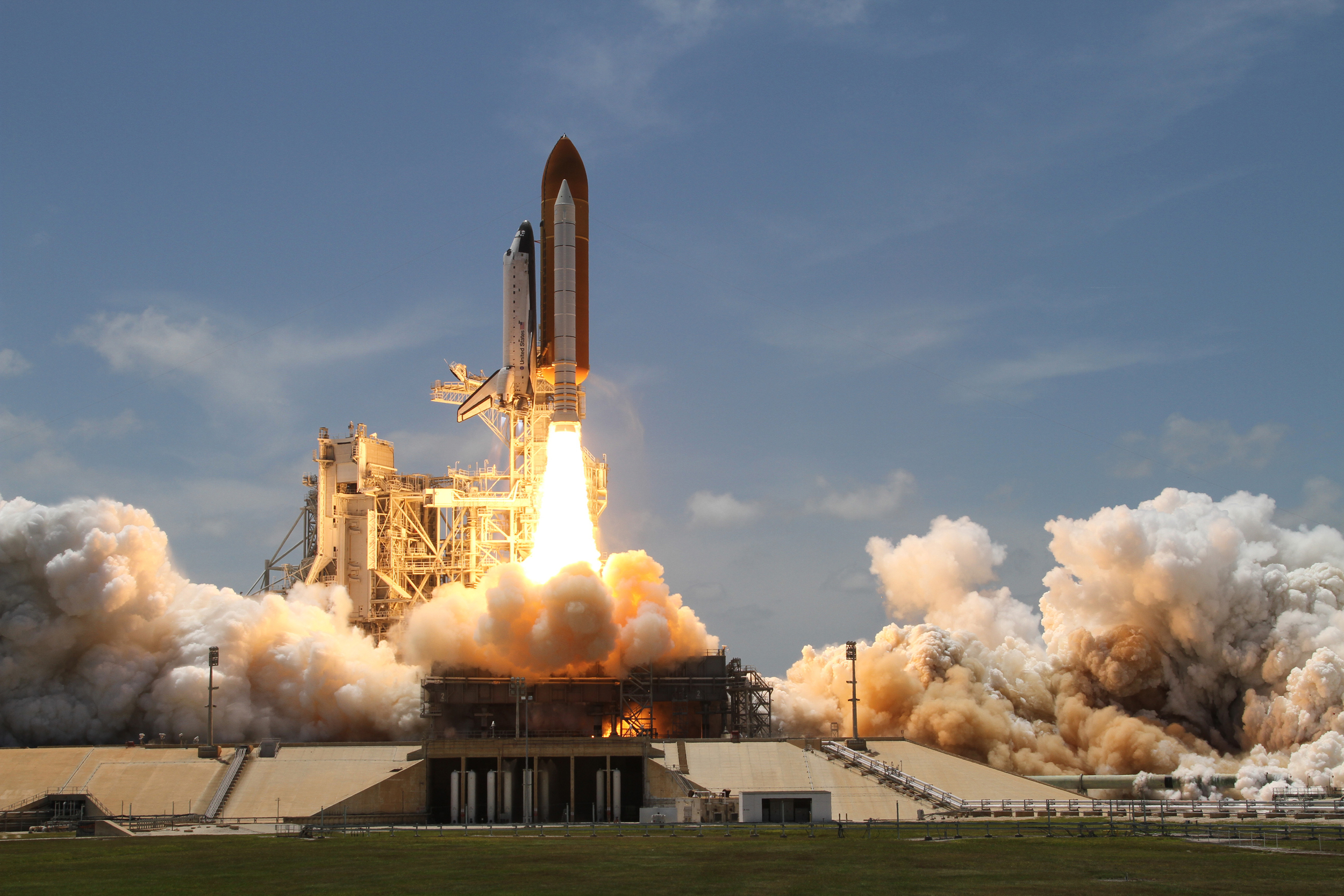 A space shuttle launches from Kennedy Space Center, Florida. Photo Credit: NASA