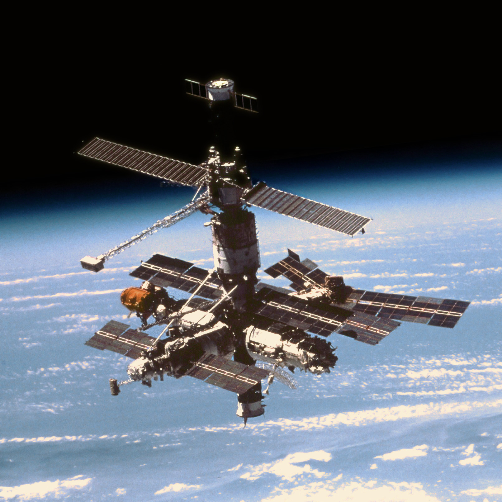 A Soyuz, bottom, docked to the Mir space station, as seen from the space shuttle Atlantis in 1997. Photo Credit: NASA