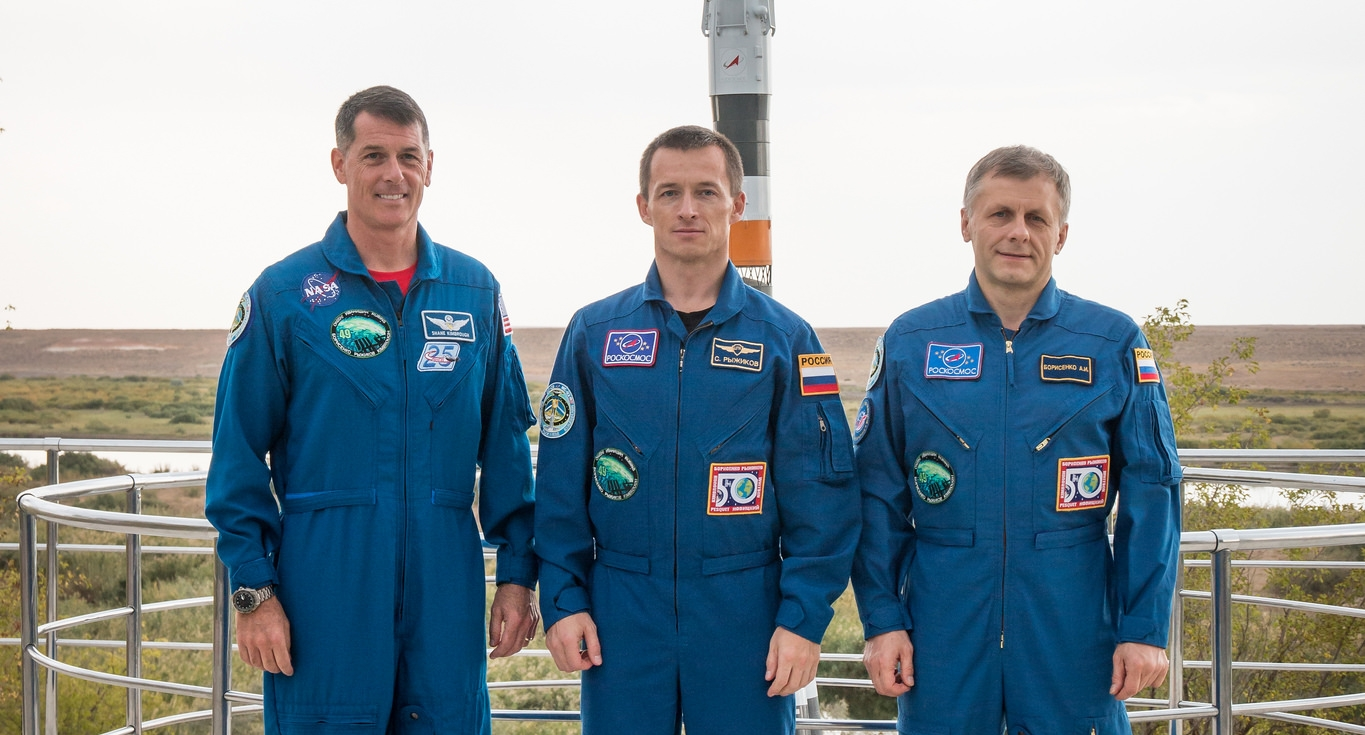 The flight of Soyuz MS-02, which will carry NASA astronaut Shane Kimbrough, left, and Russian cosmonauts Sergey Ryzhikov, center, and Andrei Borisenko to the International Space Station has been postponed. Photo Credit: Victor Zelentsov / NASA