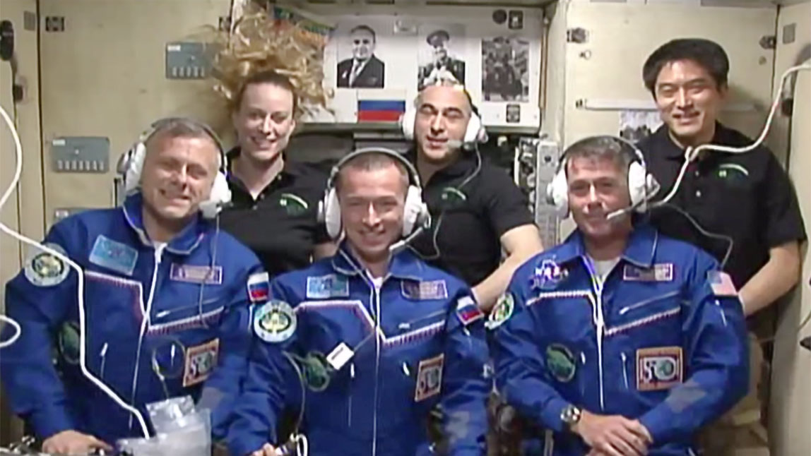 After Soyuz MS-02 docks and the crew entered the space station, the full crew went into the  Zvezda  module to conduct a post-docking conference with close friends and family. Photo Credit: NASA TV