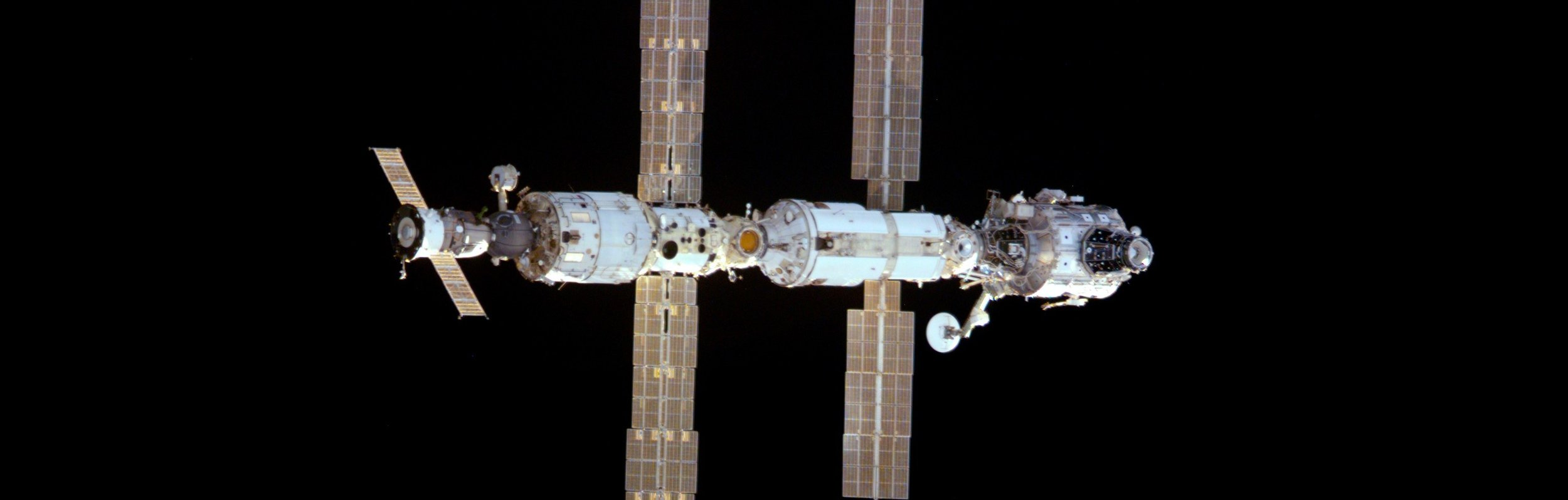 A view of the early International Space Station from space shuttle  Endeavour  in December 2000. From left to right, the major pieces are Soyuz TM-31 and the  Zvezda ,  Zarya  and  Unity  modules. Photo Credit: NASA
