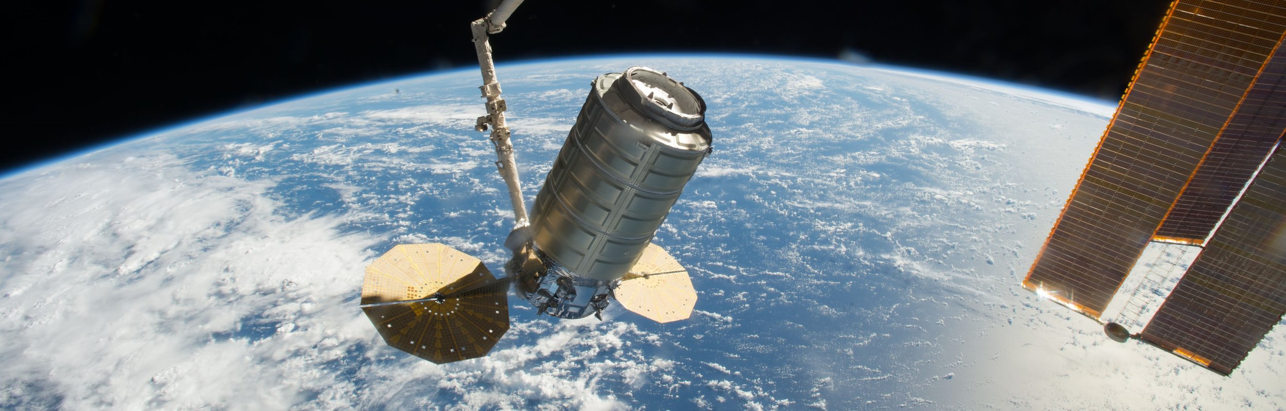 After months of delays, the OA-5 Cygnus finally arrives to the International Space Station. On Oct. 23, it was berthed to the Earth-facing port of the  Unity  module. Photo Credit: NASA