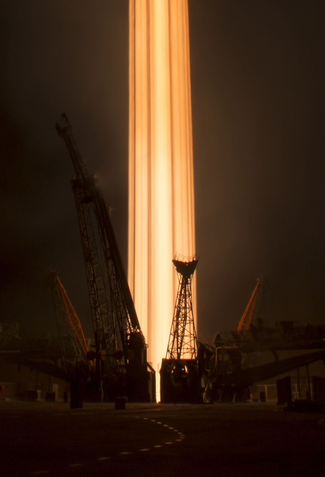 Pillar of light: The Soyuz rockets skyward in this long exposure picture. Photo Credit: Bill Ingalls / NASA