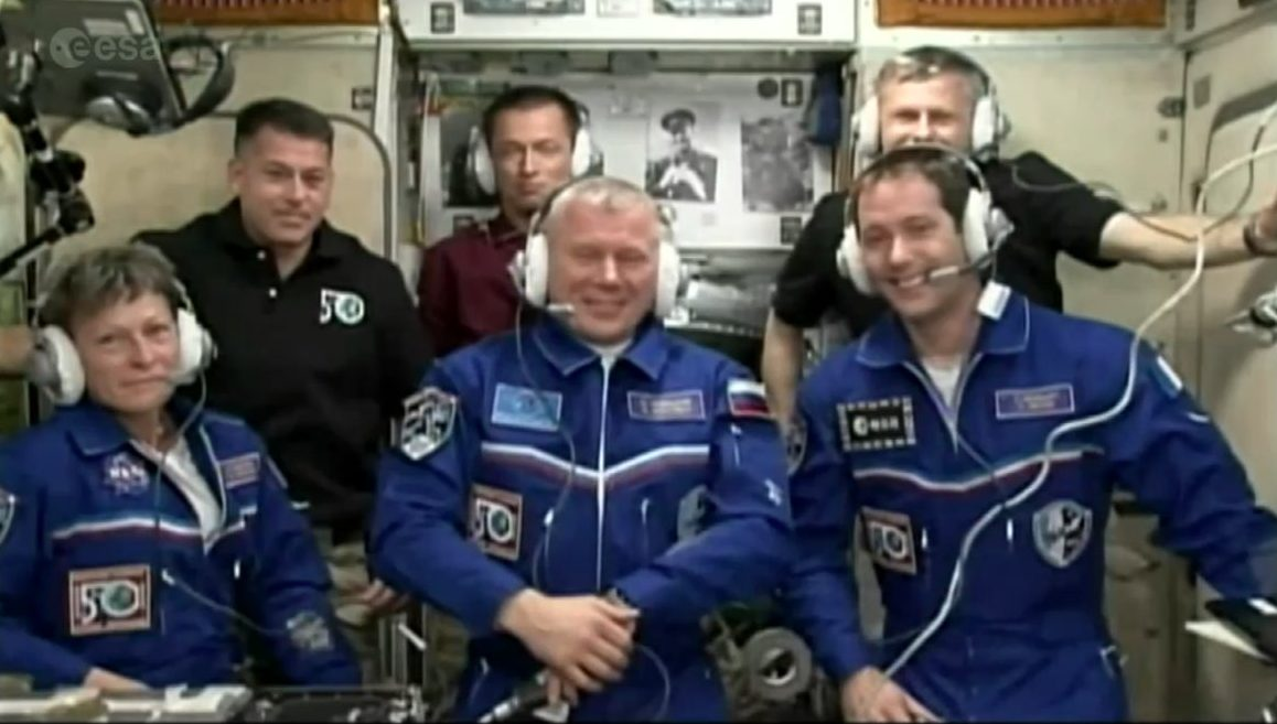 The full Expedition 50 crew gather at the rear of the  Zvezda  module for the traditional post-docking conference. Photo Credit: NASA TV