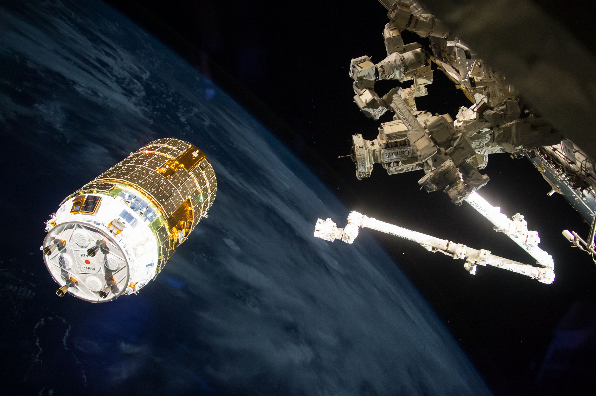 "The Japanese cargo ship station-keeps moments before the Expedition 50 crew used the robotic  Canadarm2  to ""grab"" the spacecraft. It would later be berthed to the Earth-facing port of the  Harmony  module. Photo Credit: Shane Kimbrough / NASA"