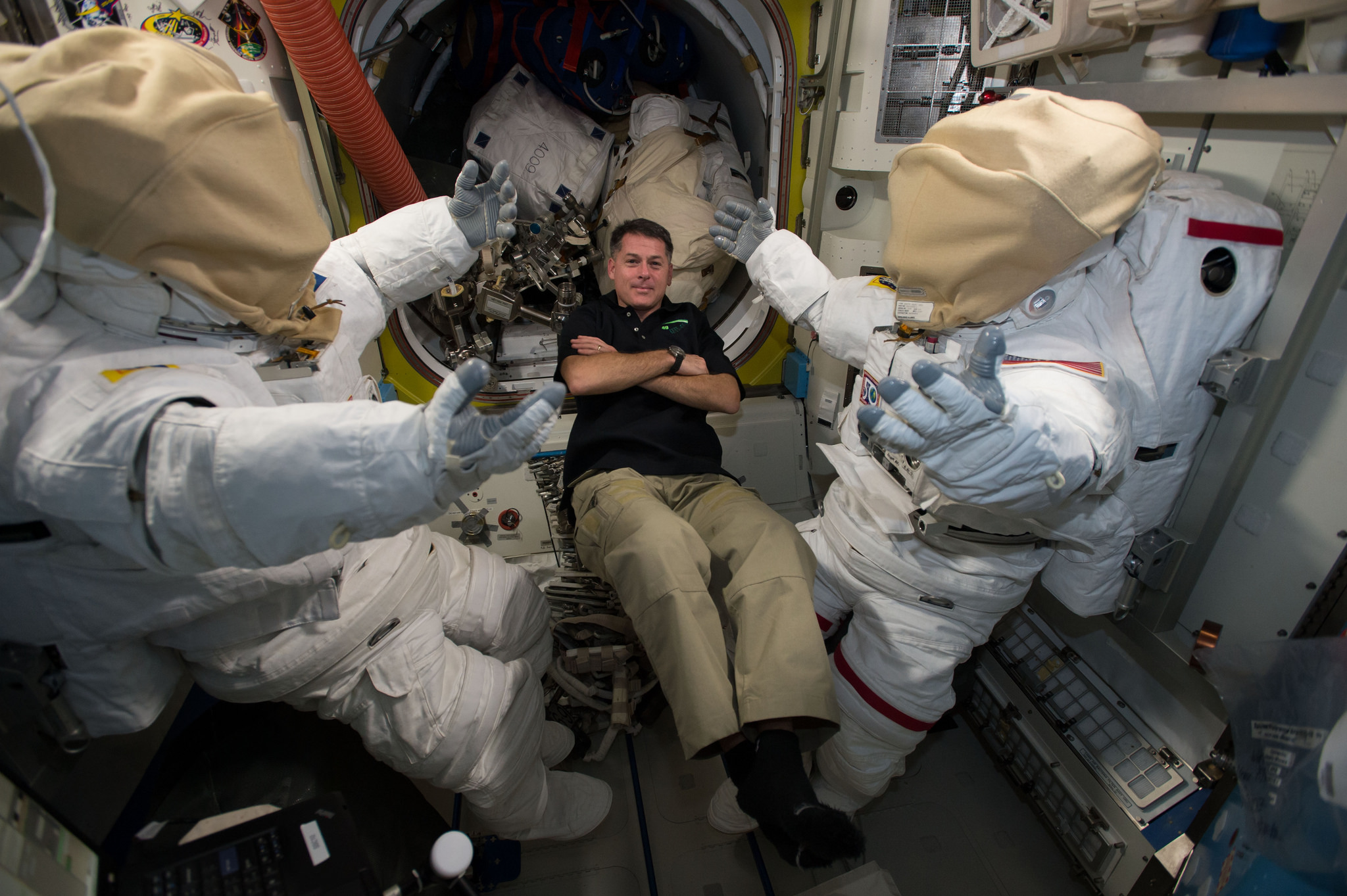 Shane Kimbrough floats next to the spacesuits he was performing maitenence on in advance of January's spacewalks. Photo Credit: NASA