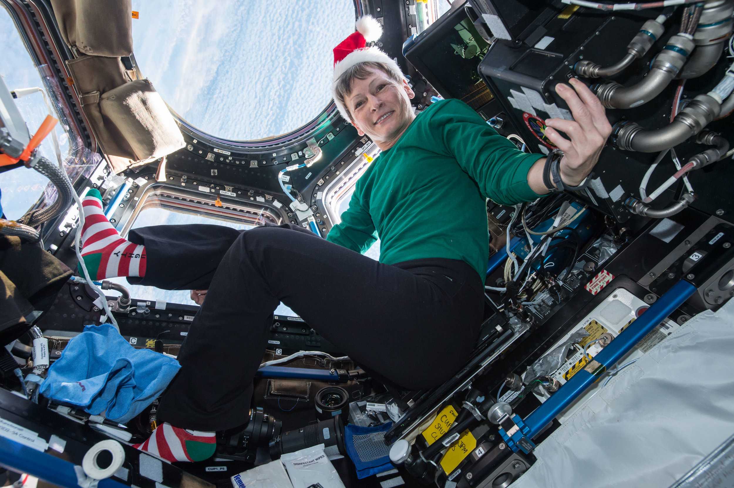 Peggy Whitson floats in the Cupola. Photo Credit: NASA