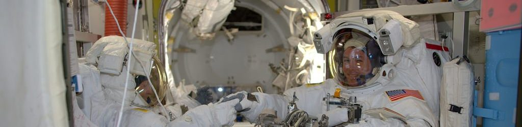Shane Kimbrough, right, and Peggy Whitson shake hands before venturing into the Quest airlock to begin a 6.5-hour spacewalk to help upgrade the International Space Station's power system. Photo Credit: Thomas Pesquet / NASA