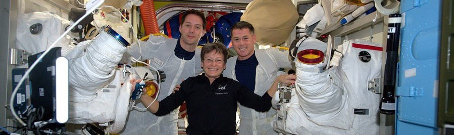Spacewalkers Thomas Pesquet, left, and Shane Kimbrough, right, pose with Peggy Whitson after completing EVA-39. Whitson assisted teh two from inside the International Space Station during their spacewalk. Photo Credit: NASA